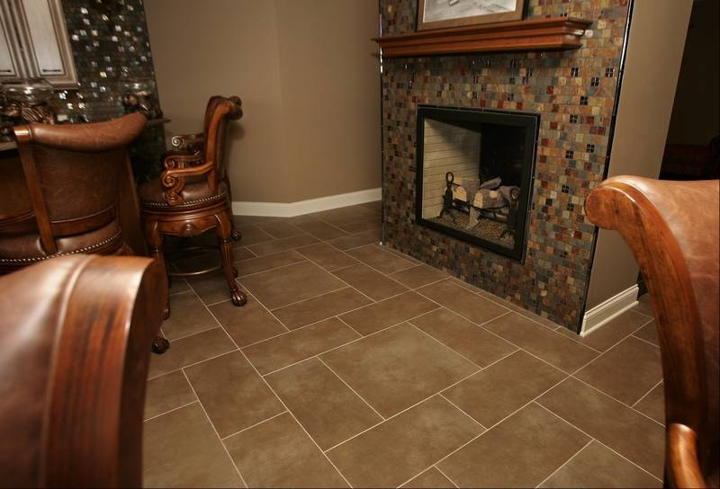 Tile moves from floors to the wall for Best tile for basement floor