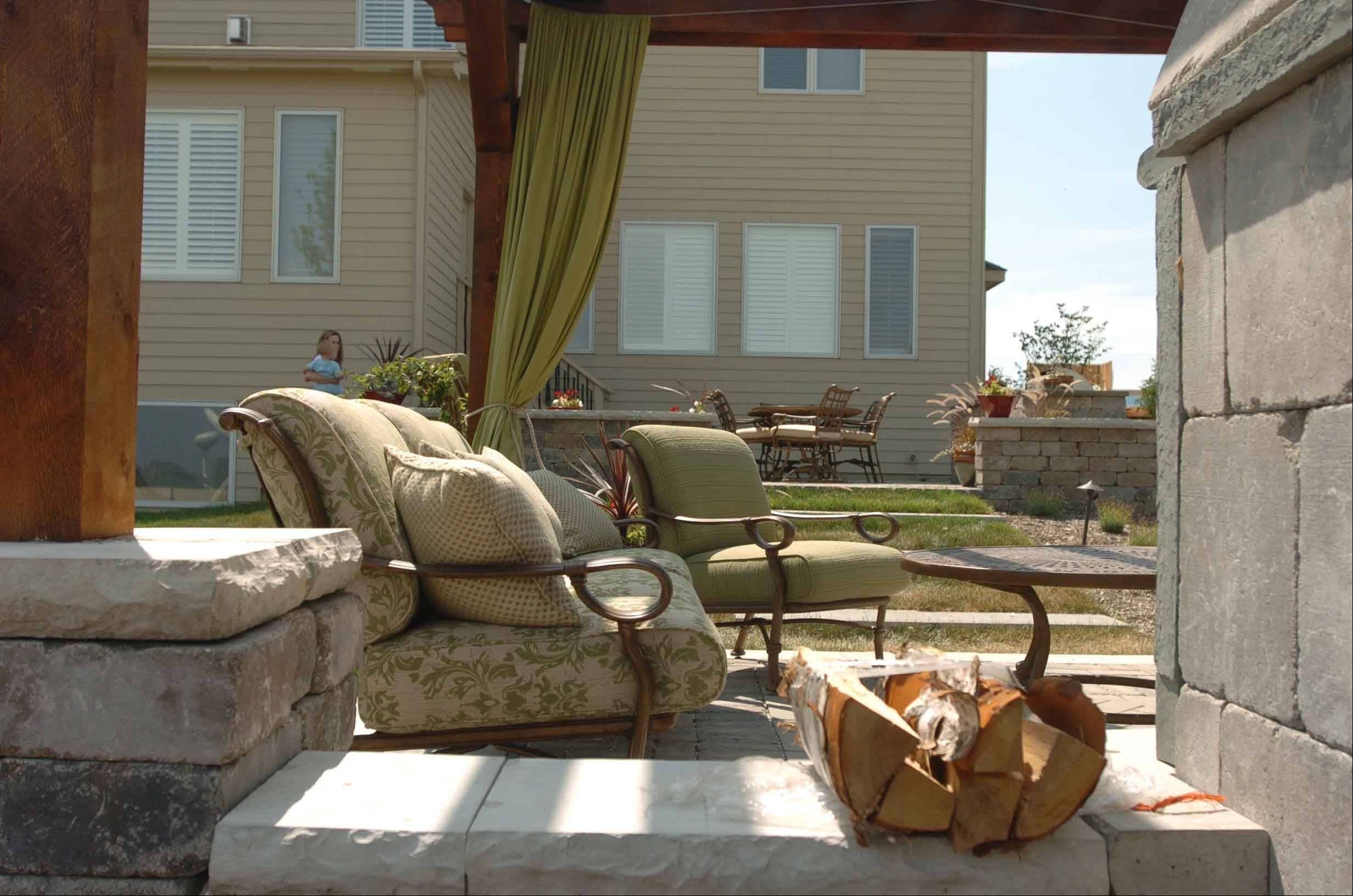 The Jakovich home in Plainfield has plenty of outdoor furniture.