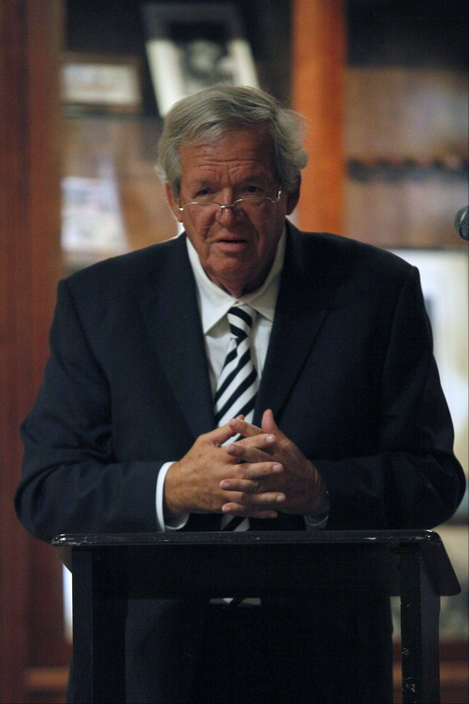 Former U.S. speaker of the House Dennis Hastert talks to a group of visitors at the Wheaton Center for History on Sunday, to mark the launch the center's new Civil War exhibit.