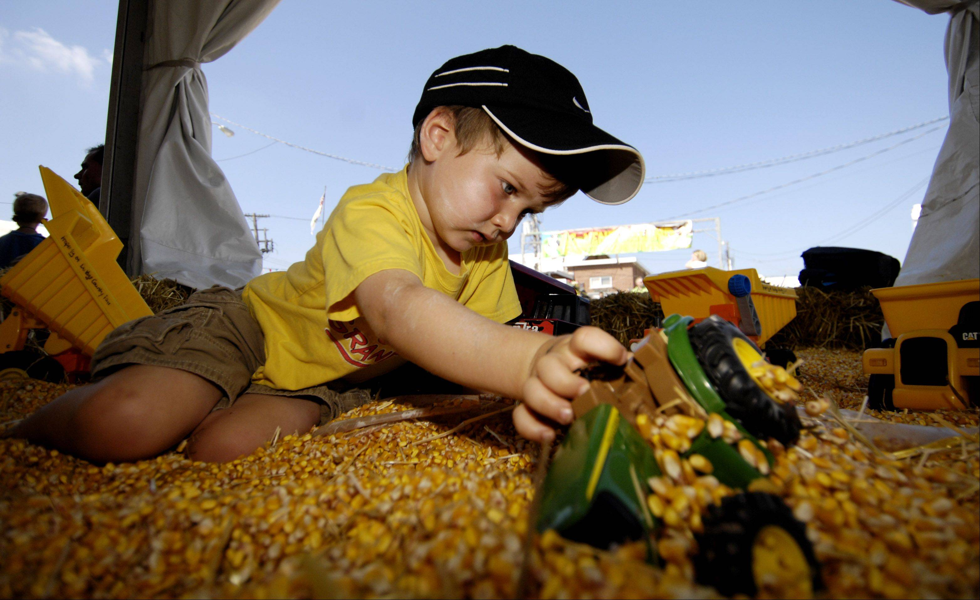 Jack Nelson, 4 of Wheaton plays in the corn play pit.