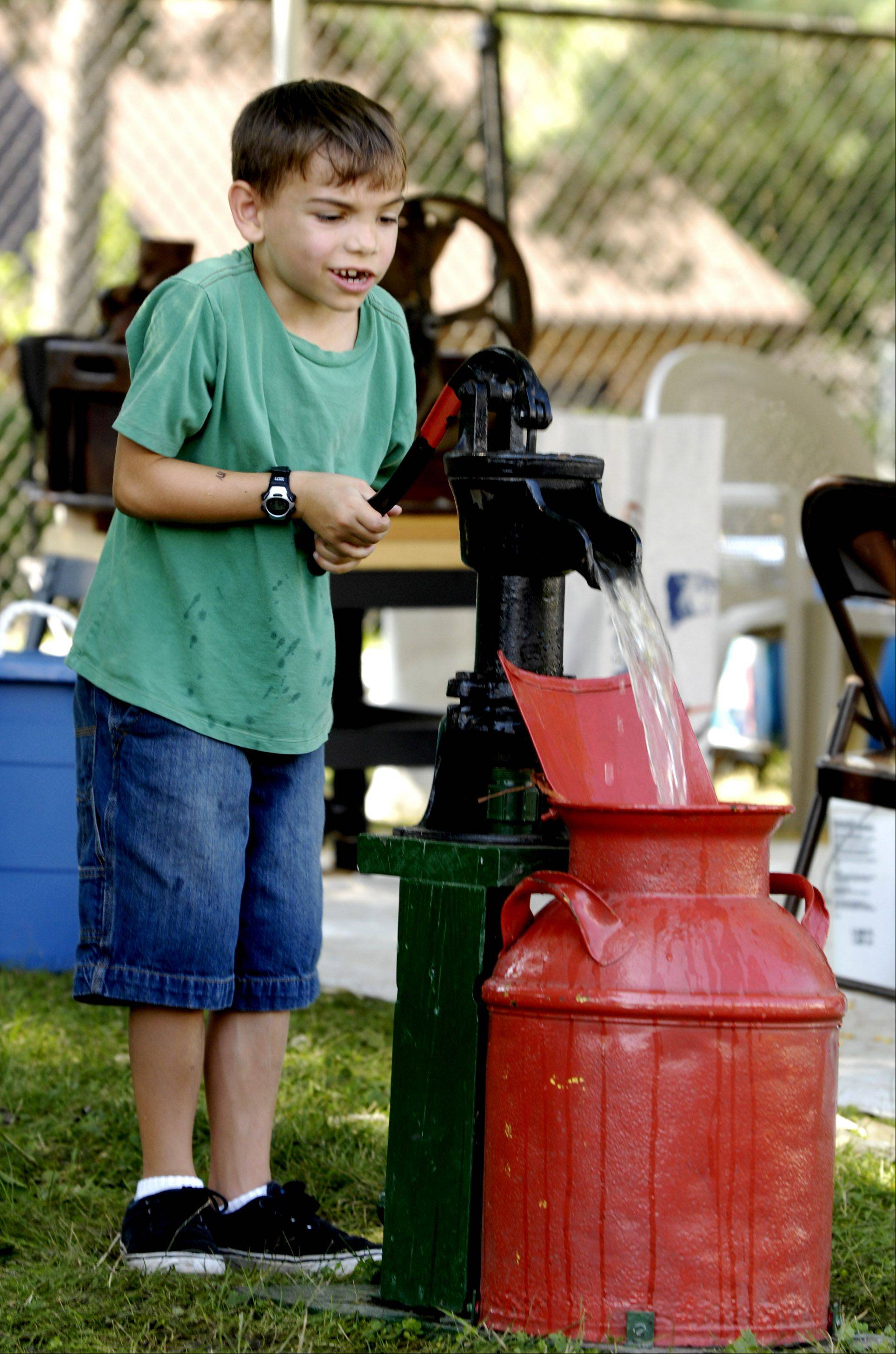 Anthony Tipton, 7 of Carol Stream, tries pumping water.