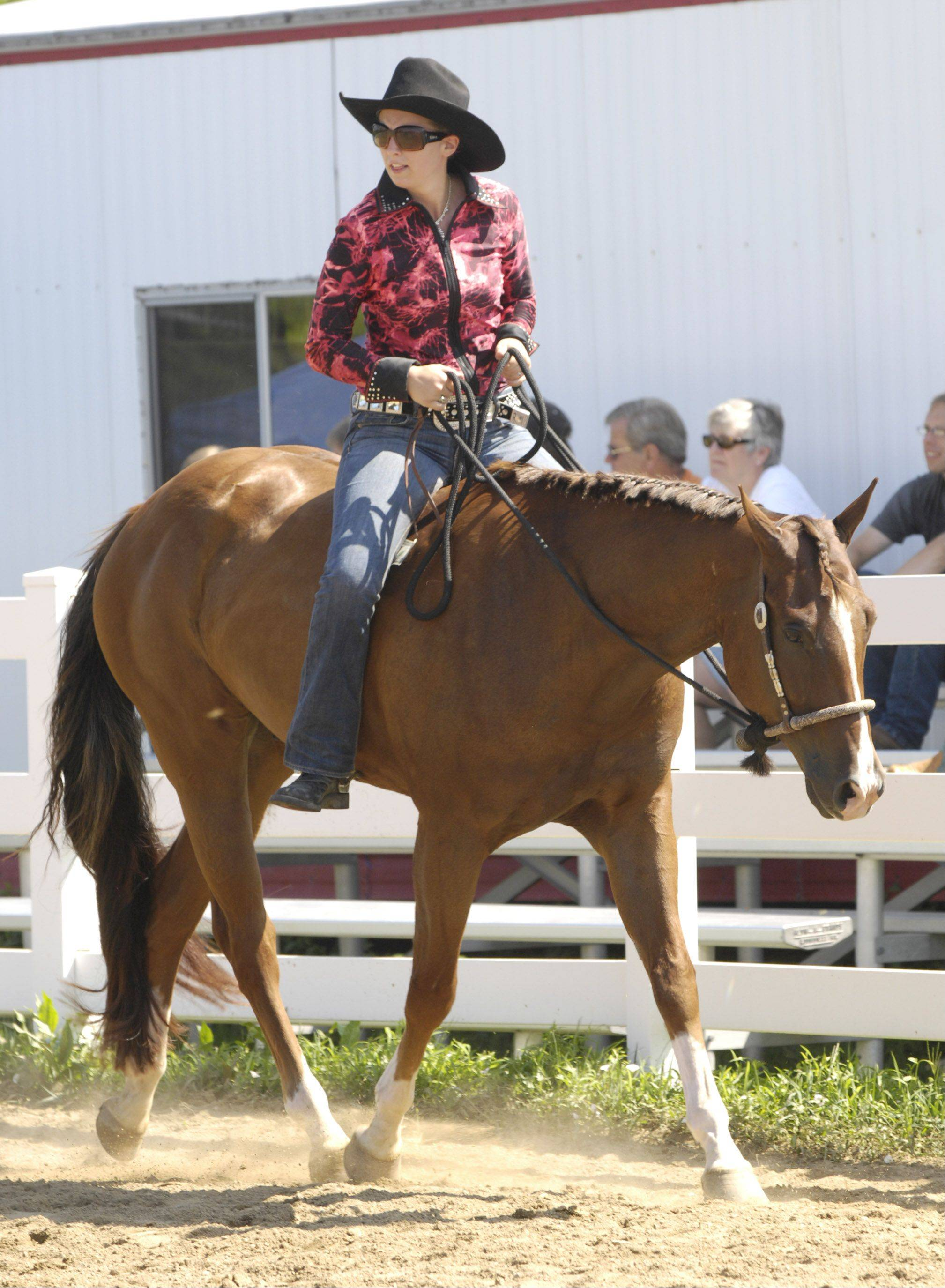 "Brittany Ryan of Coal City rides ""Boomer"" during the ""Ride a Buck"" competition."