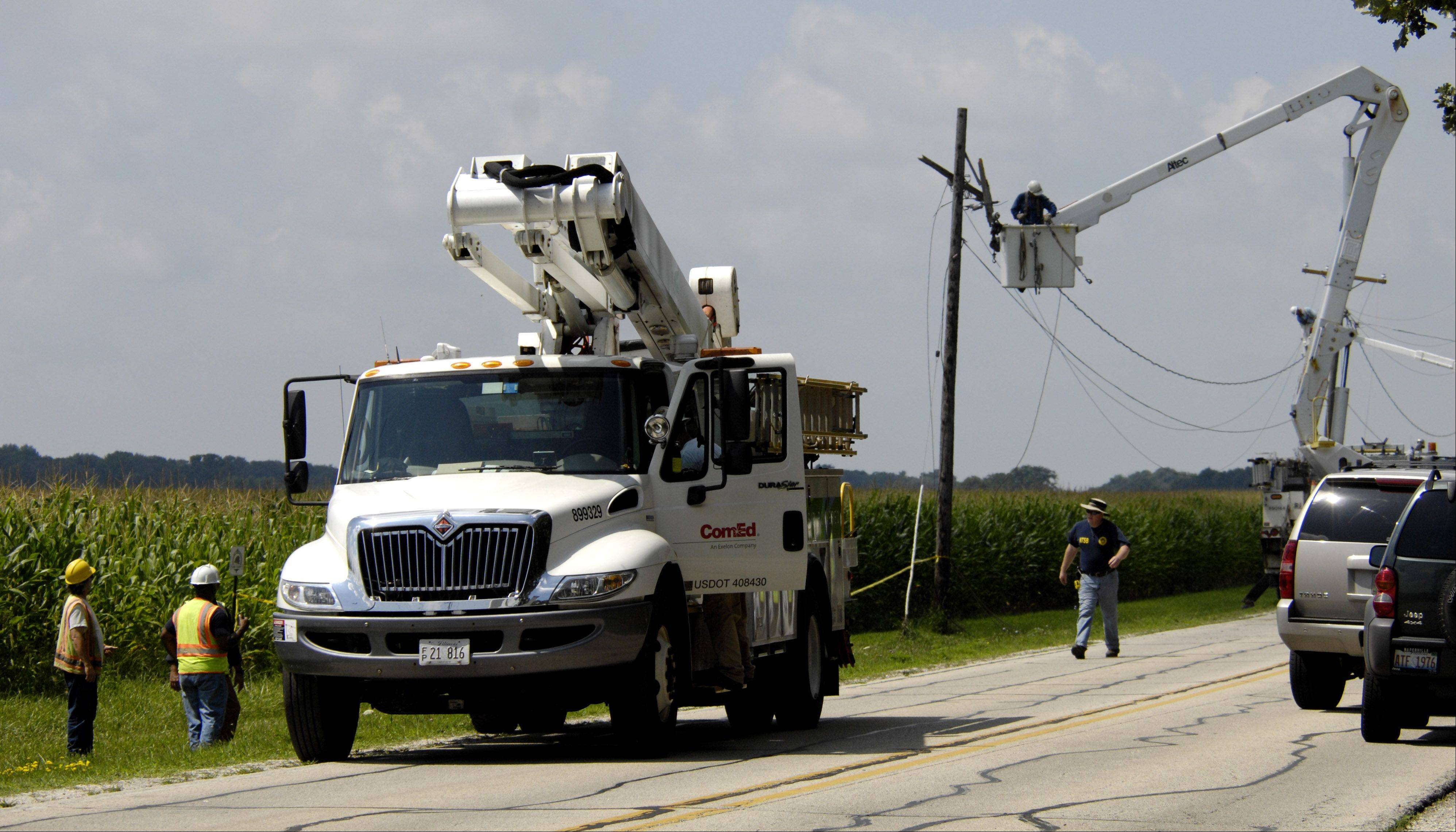 ComEd crews work to restore electricity near Sugar Grove after an experimental airplane clipped the power lines before crashing into a cornfield Sunday west of Aurora. The crash killed the plane's pilot, a 73-year-old Aurora man who'd survived two previous crashes.