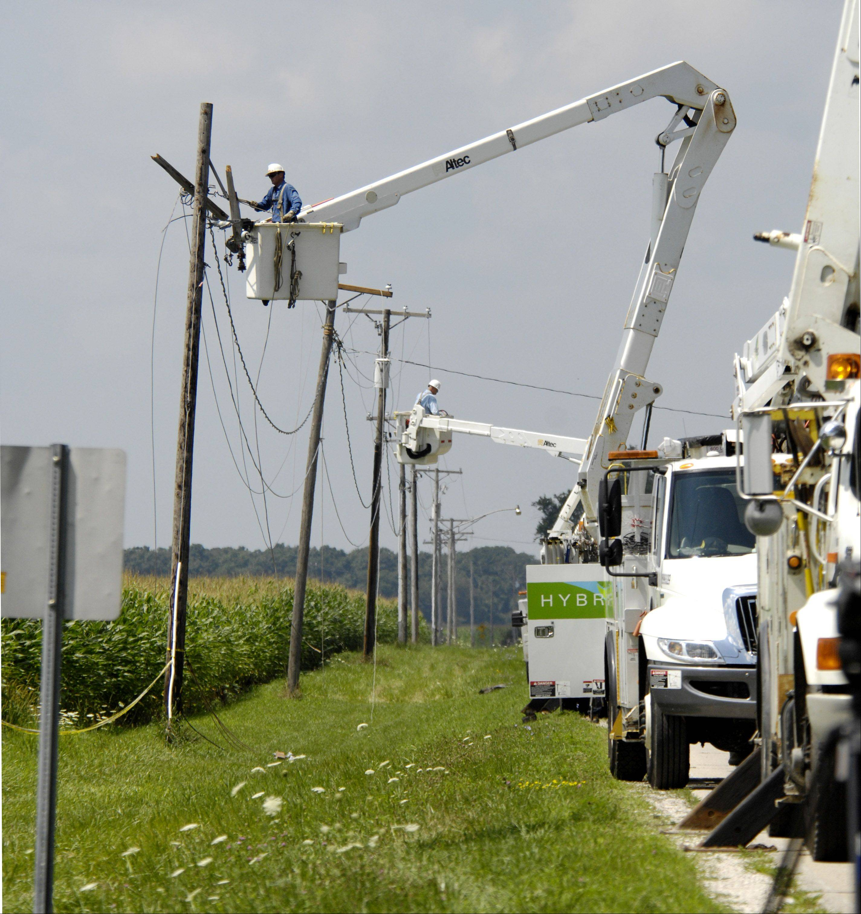 ComEd crews work to restore electricity near Sugar Grove after an experimental airplane clipped the power lines before crashing into a cornfield Sunday. The crash killed the plane's pilot, a 73-year-old Aurora man who'd survived two previous crashes.