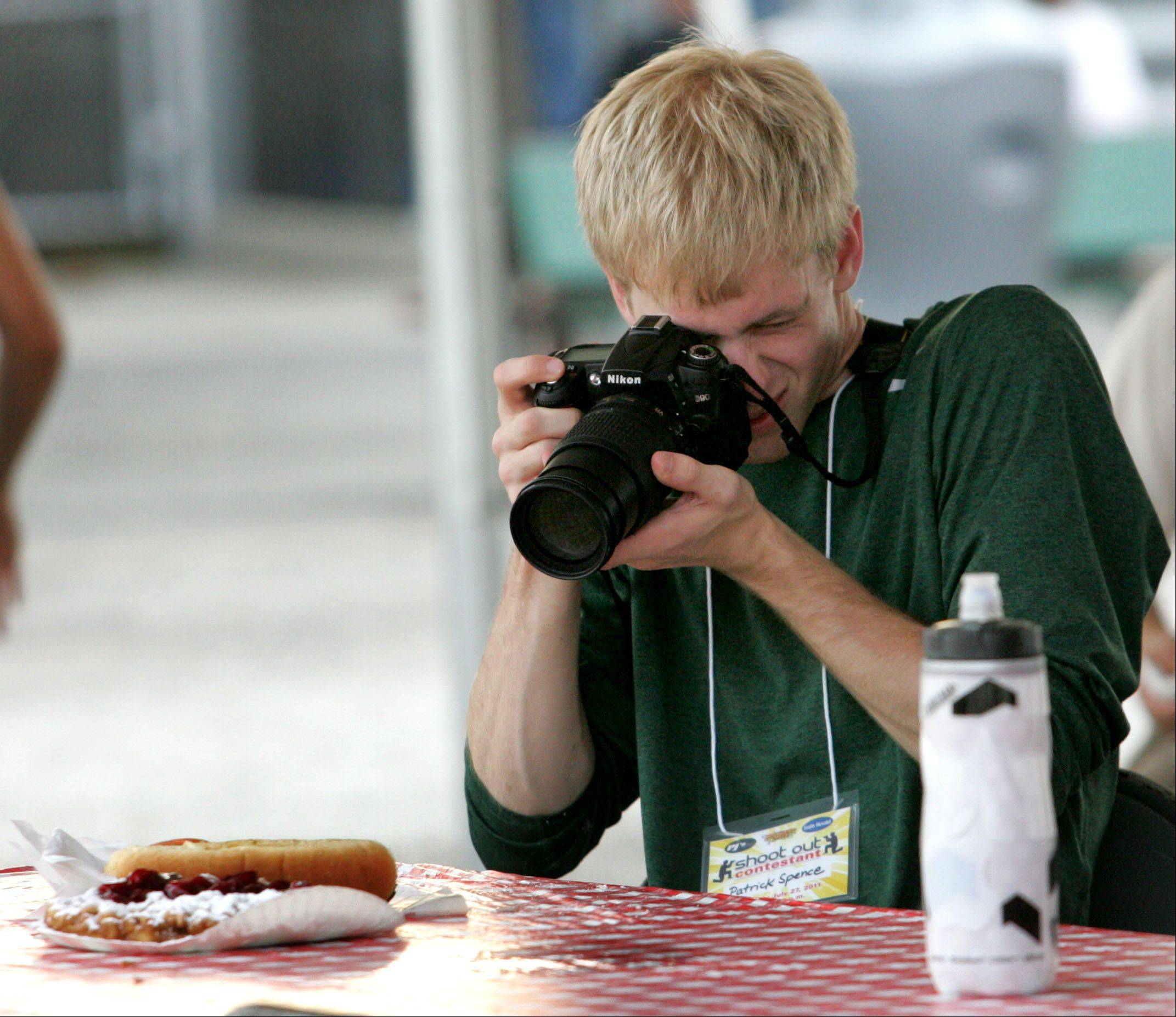 Patrick Spence of Naperville works at shooting his first-place photo for the first Photography Shoot-Out contest at the DuPage County Fair in Wheaton.