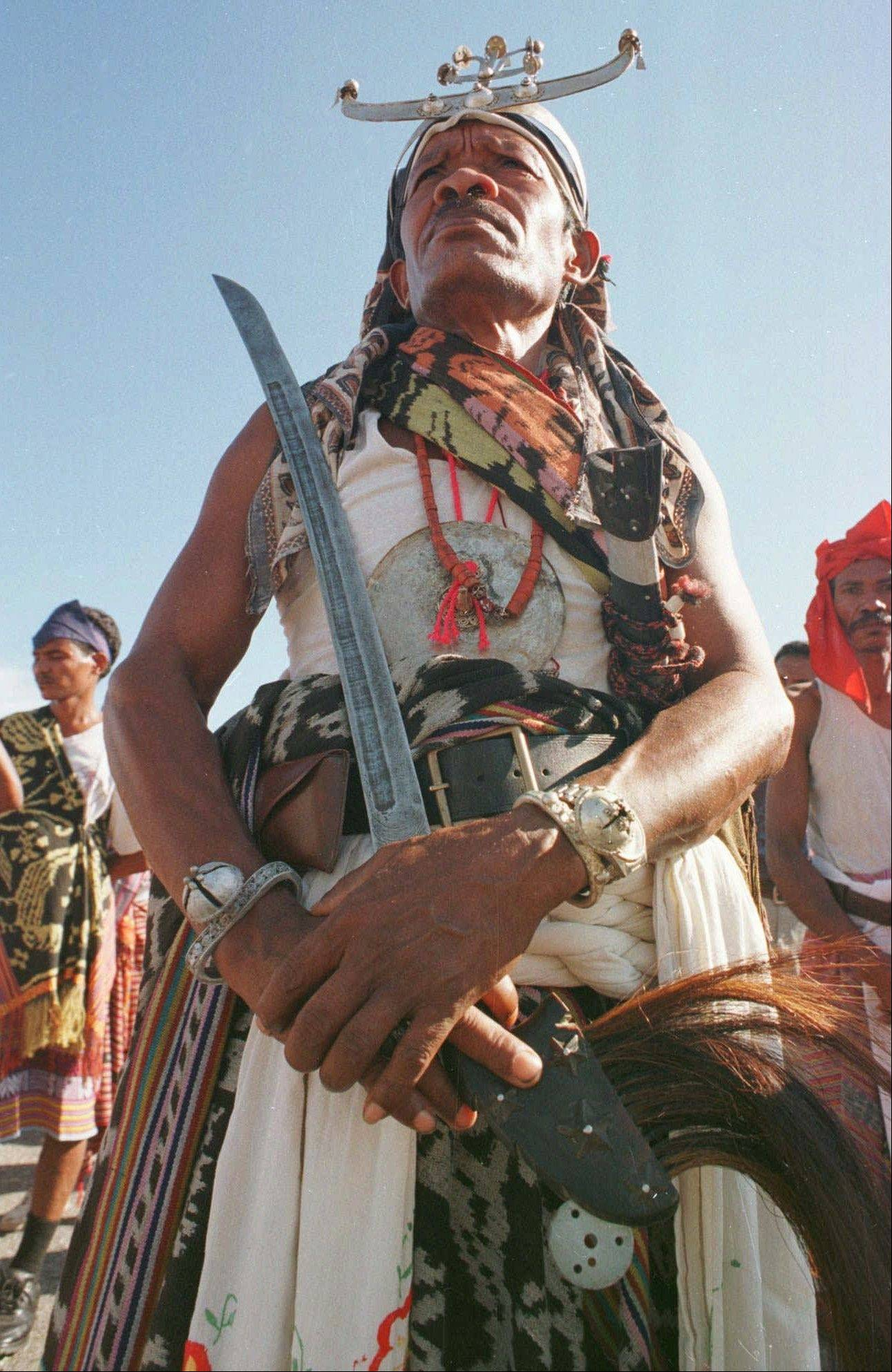 An East Timorese man wearing traditional tribal clothing stands at attention during Integration Day celebrations at the governor's office in Dili, about 1,250 miles east of Jakarta. The annual celebration marked the former Portuguese colony's annexation by Indonesia in 1976 following its invasion a year earlier. East Timor became a sovereign state in 2001.