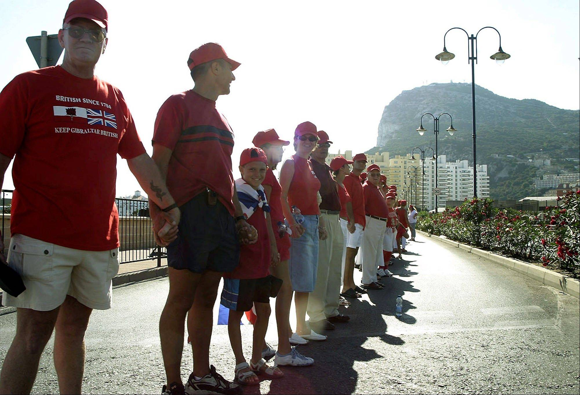 Gibraltar residents form a human chain around the British colony at the tip of the Iberian Peninsula, celebrating the 300th anniversary of the territory's capture from Spain. Spain wants it back, but Britain says the decision lies with the inhabitants of the Mediterranean enclave.