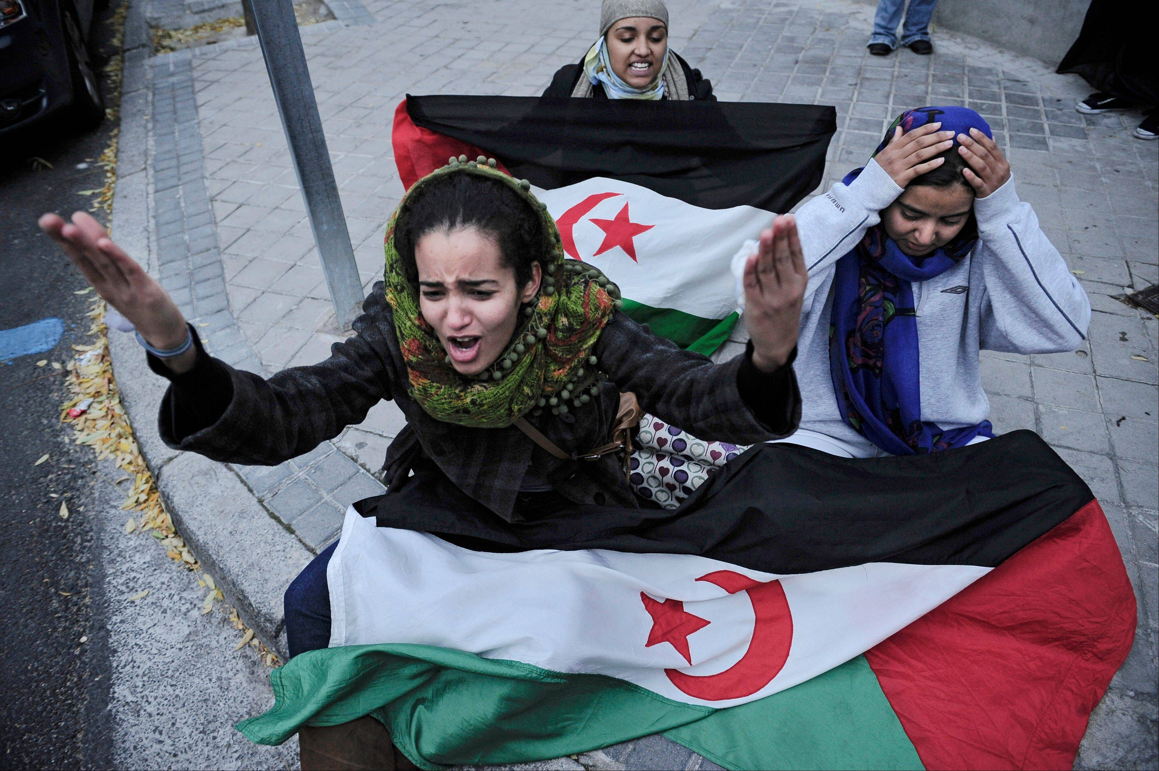 Saharan women protest in front of the Moroccan Embassy in Madrid following deadly clashes with Moroccan authorities in the disputed territory of Western Sahara. The territory, once ruled by Spain, is now claimed by Morocco, which has rejected a self-determination vote, instead proposing wide-ranging autonomy.