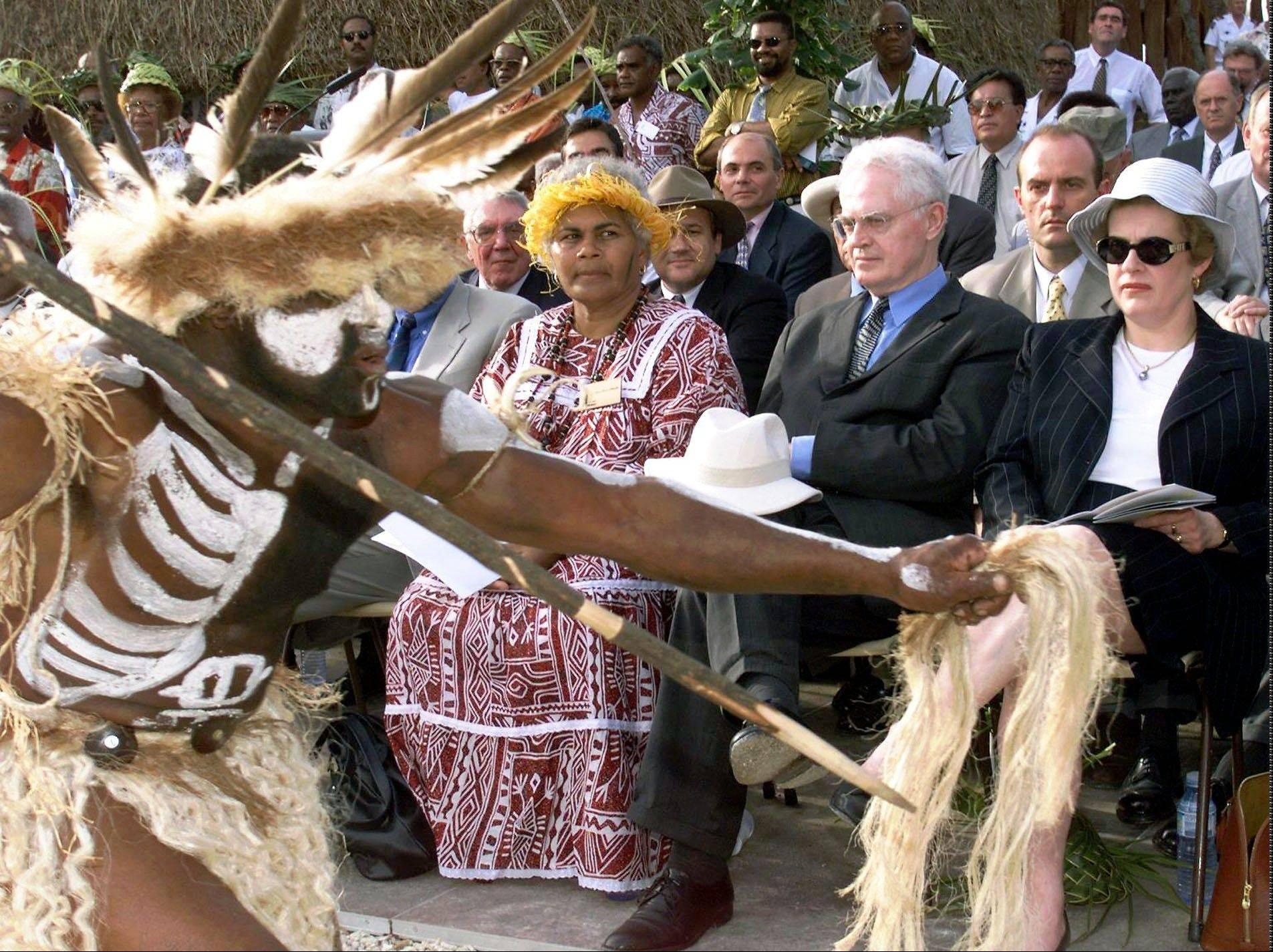 French Prime Minister Lionel Jospin, center, and Culture Minister Catherine Trautman, right, watch dancers during the inauguration of the Jean-Marie Tjibaou cultural center in Noumea, the capital of the French Pacific islands of New Caledonia. At Jospin's right is the widow of Tjibaou, independence leader assassinated in 1989.