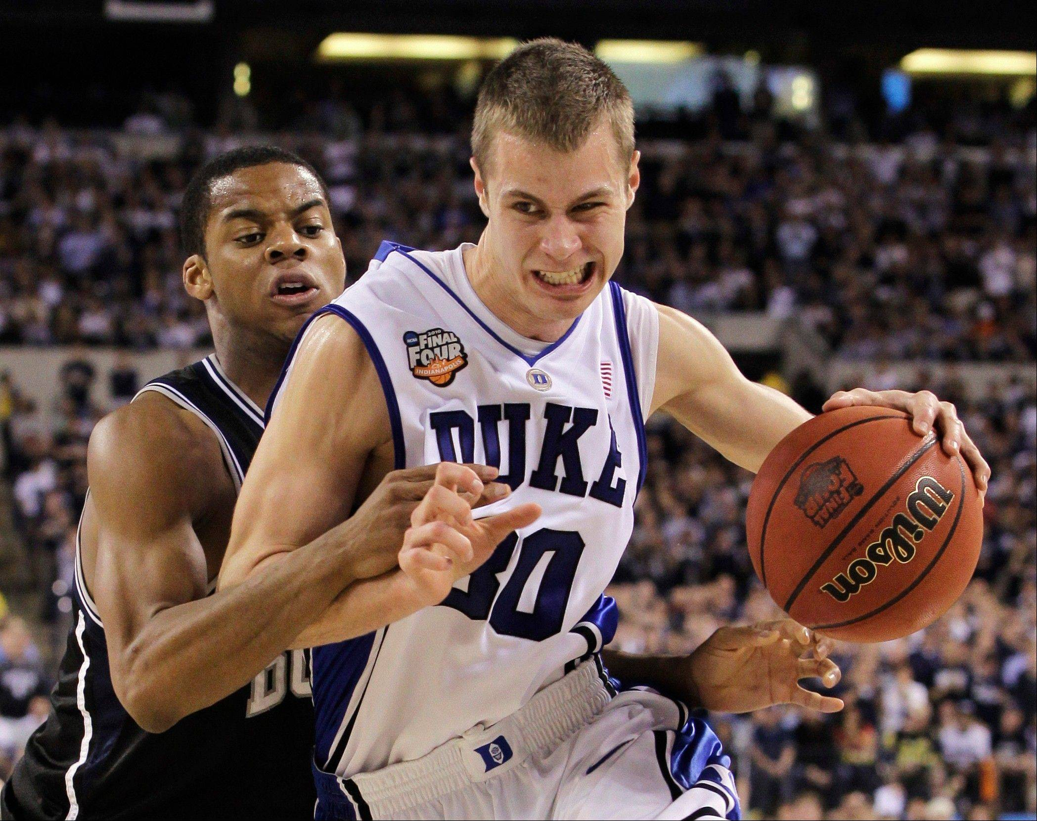 Guard Jon Scheyer, shown playing for Duke in the 2010 NCAA men's title game, has joined perennial basketball powerhouse Maccabi Tel Aviv in Israel.