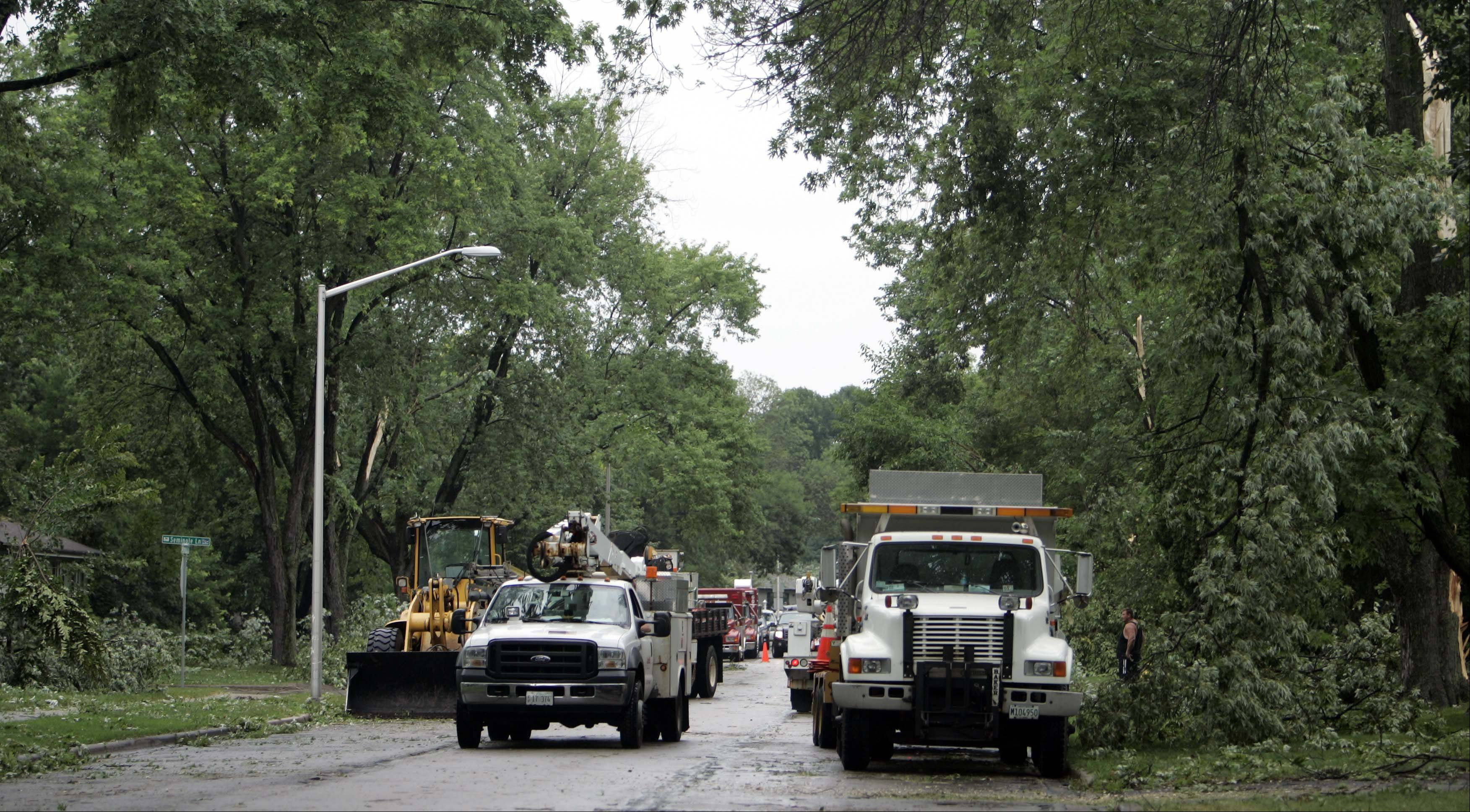 Crews removed downed trees from Thunderbird Trail in Carol Stream Thursday. The village received mutual aid assistance from nearby towns after declaring a state of disaster.