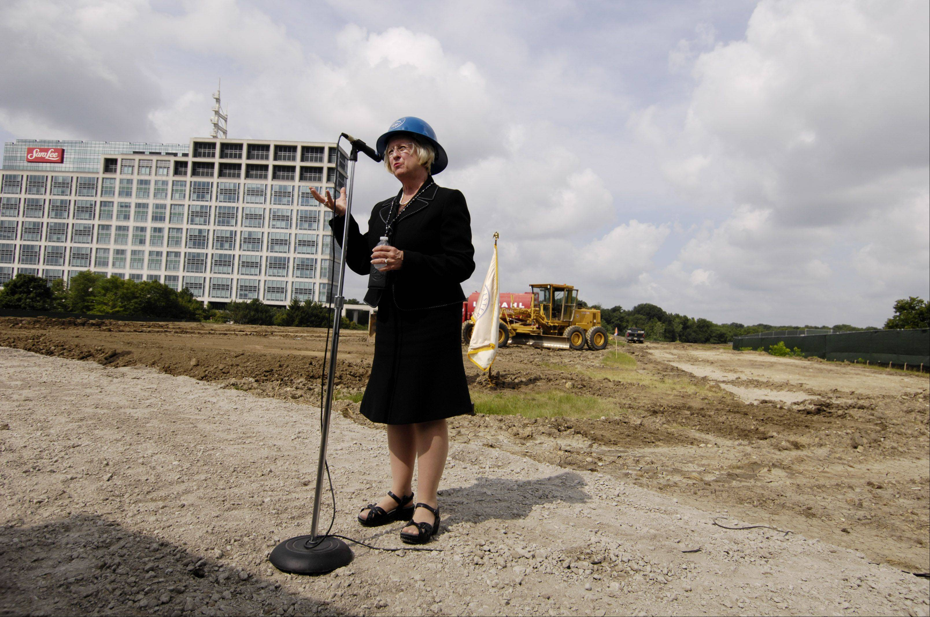 Midwestern University President and CEO Dr. Kathleen H. Goeppinger speaks during the ground breaking for a new clinic in Downers Grove.