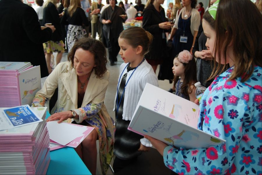 "Aleksandra Efimova of Riverwoods signs her ""Sleeping Beauty Ballet"" book at the Joffrey Ballet in May."