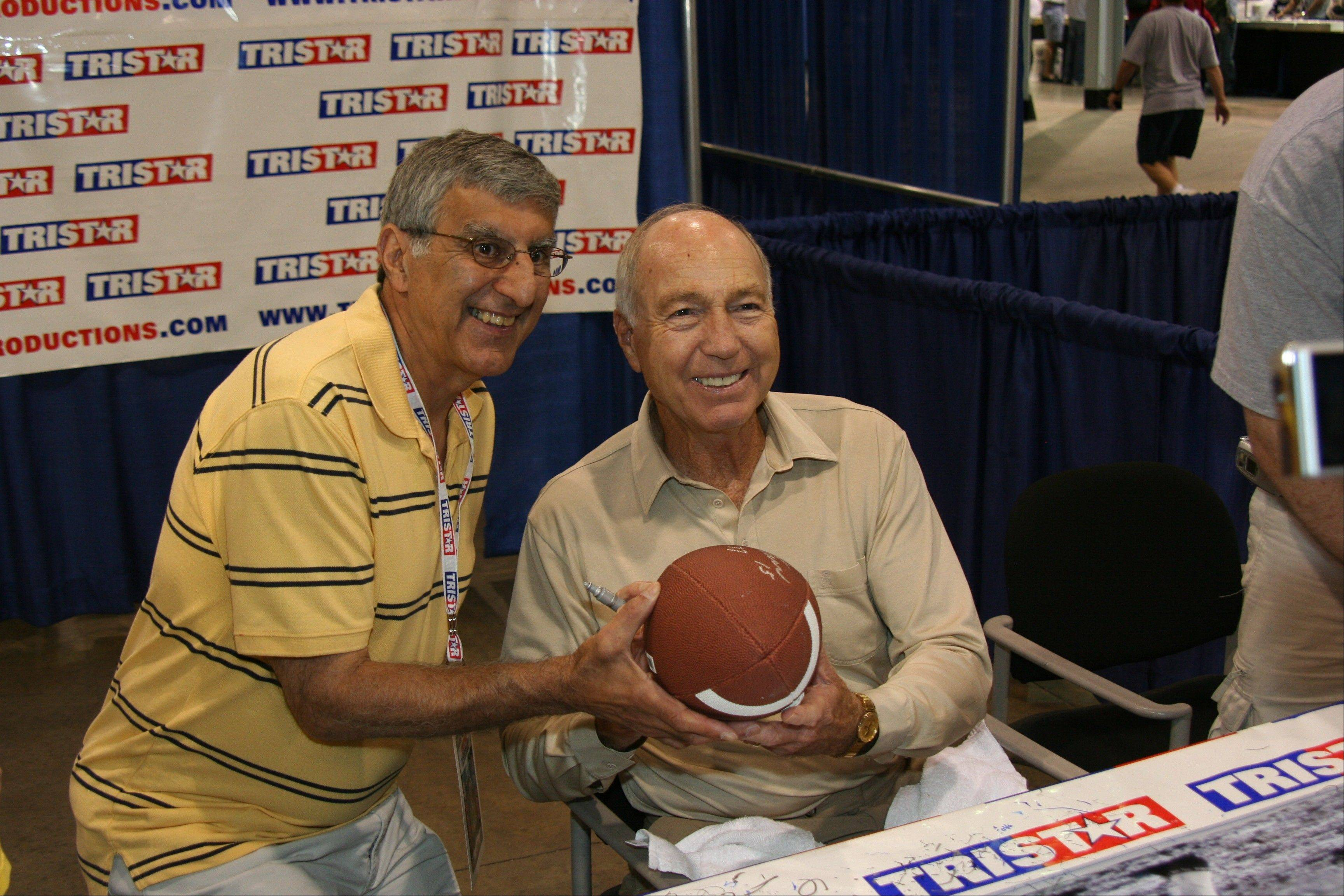 Bart Starr has his photo taken with a fan at a previous convention.