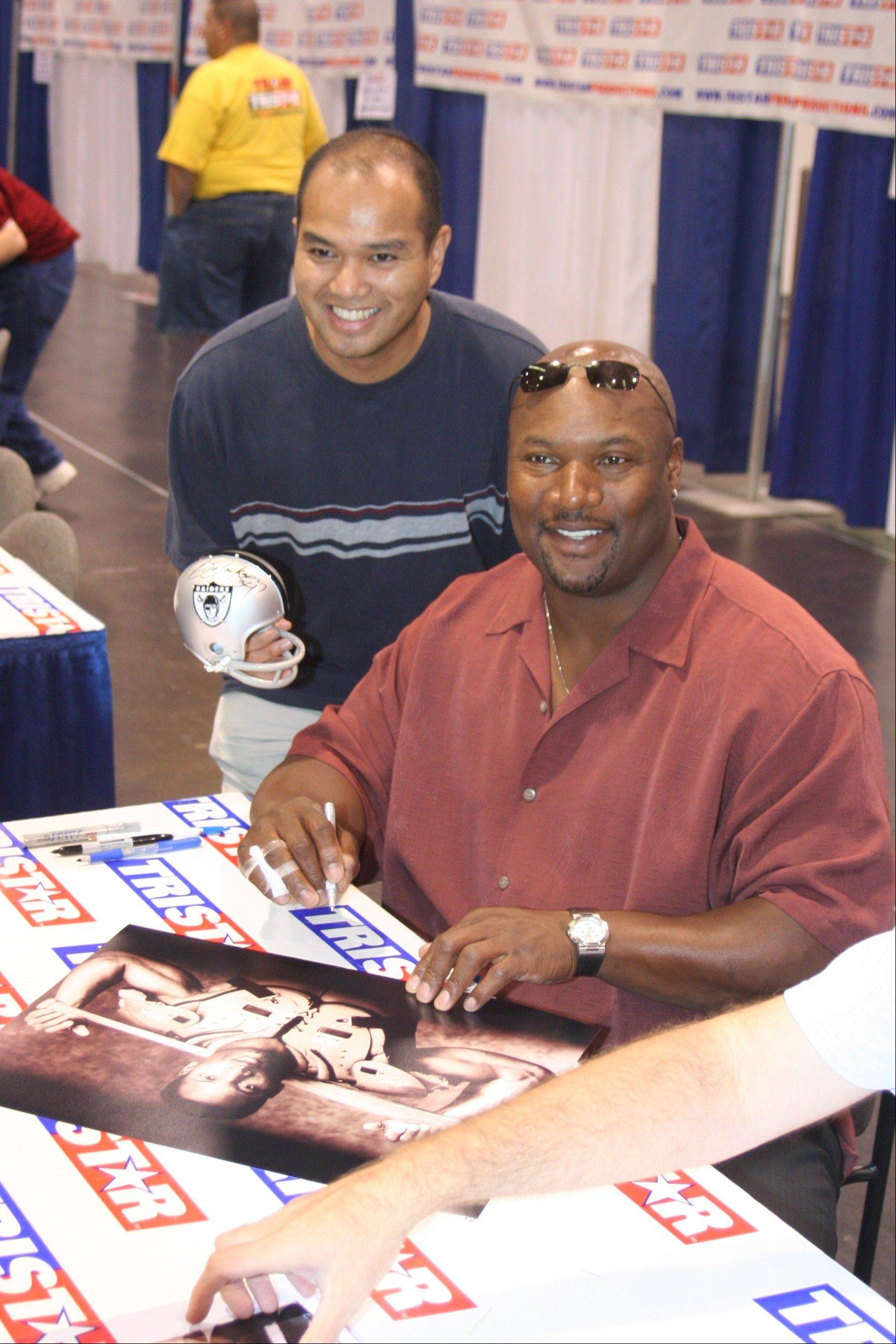 Bo Jackson, right, with a fan.