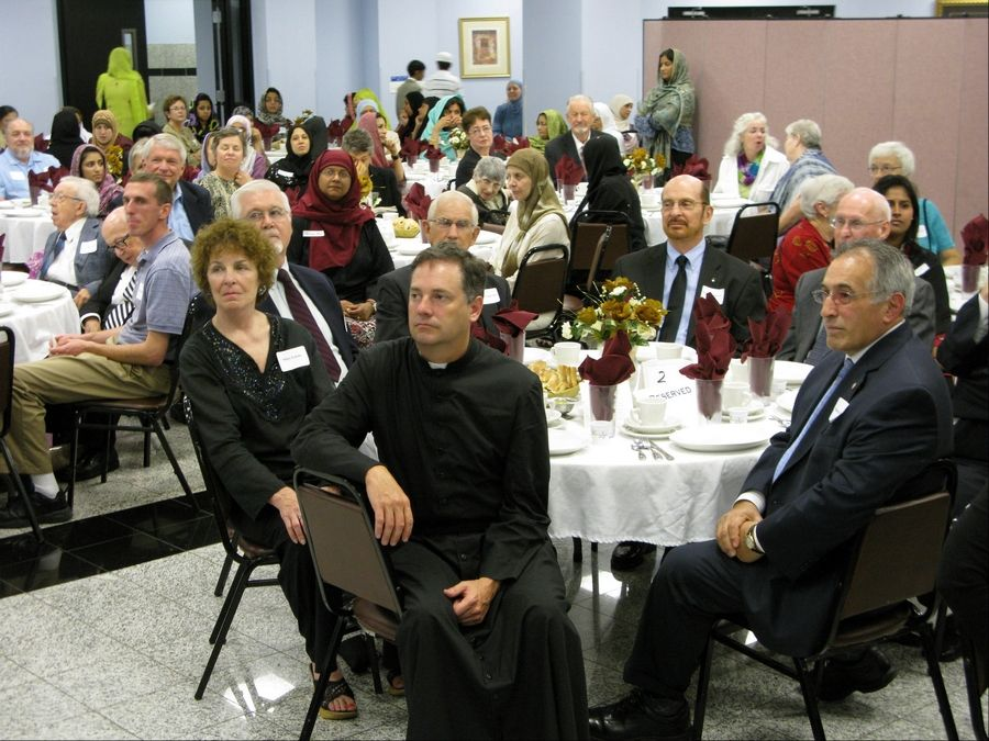 Des Plaines Mayor Marty Moylan, right, was among a crowd of more than 300 representing area Islamic, Jewish, and Christian communities who attended the 10th annual Interfaith Unity Iftar, or fast-breaking meal, at the Islamic Community Center of Des Plaines.