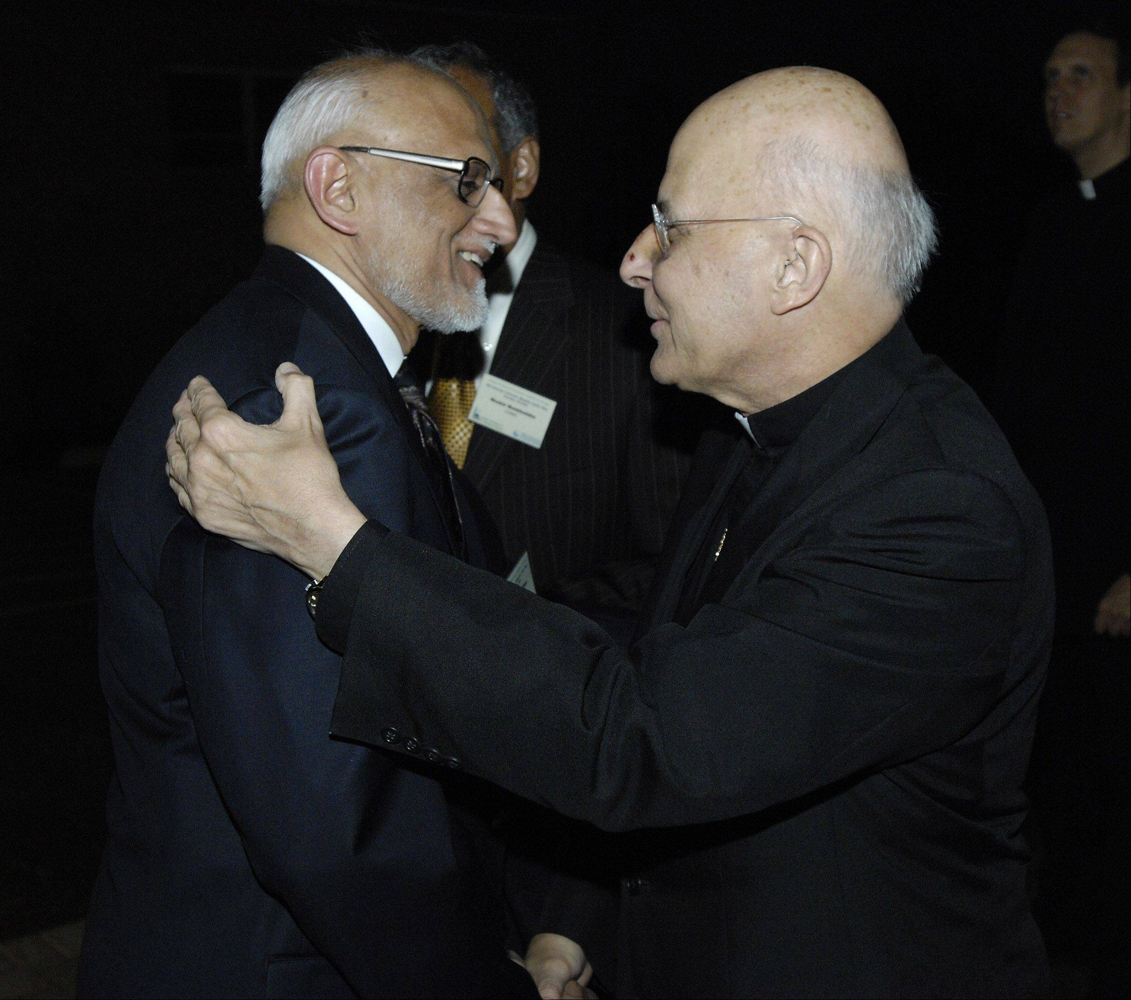 Islamic Society of Northwest Suburbs President Quadir Hussain Khan greets Francis Cardinal George in 2007 at the 9th Annual Catholic-Muslim Unity Ramadan Dinner in Rolling Meadows.