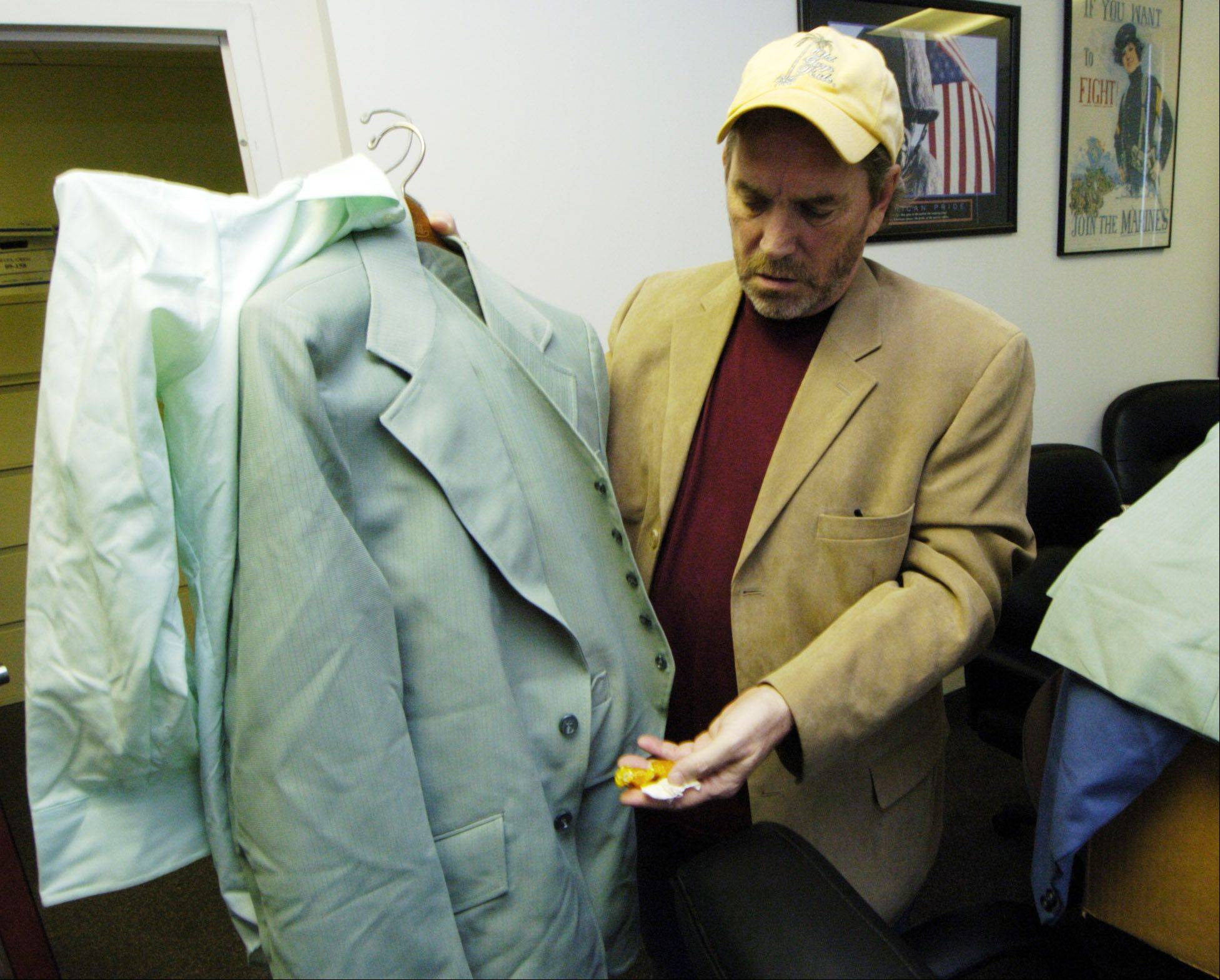 "Danny Broderick holds a suit which notorious killer John Wayne Gacy wore to court in 1980. One pocket of the suit still holds butterscotch candies. Broderick co-authored a book with Sam Amirante, John Wayne Gacy's defense attorney, entitled, ""Defending a Monster."""