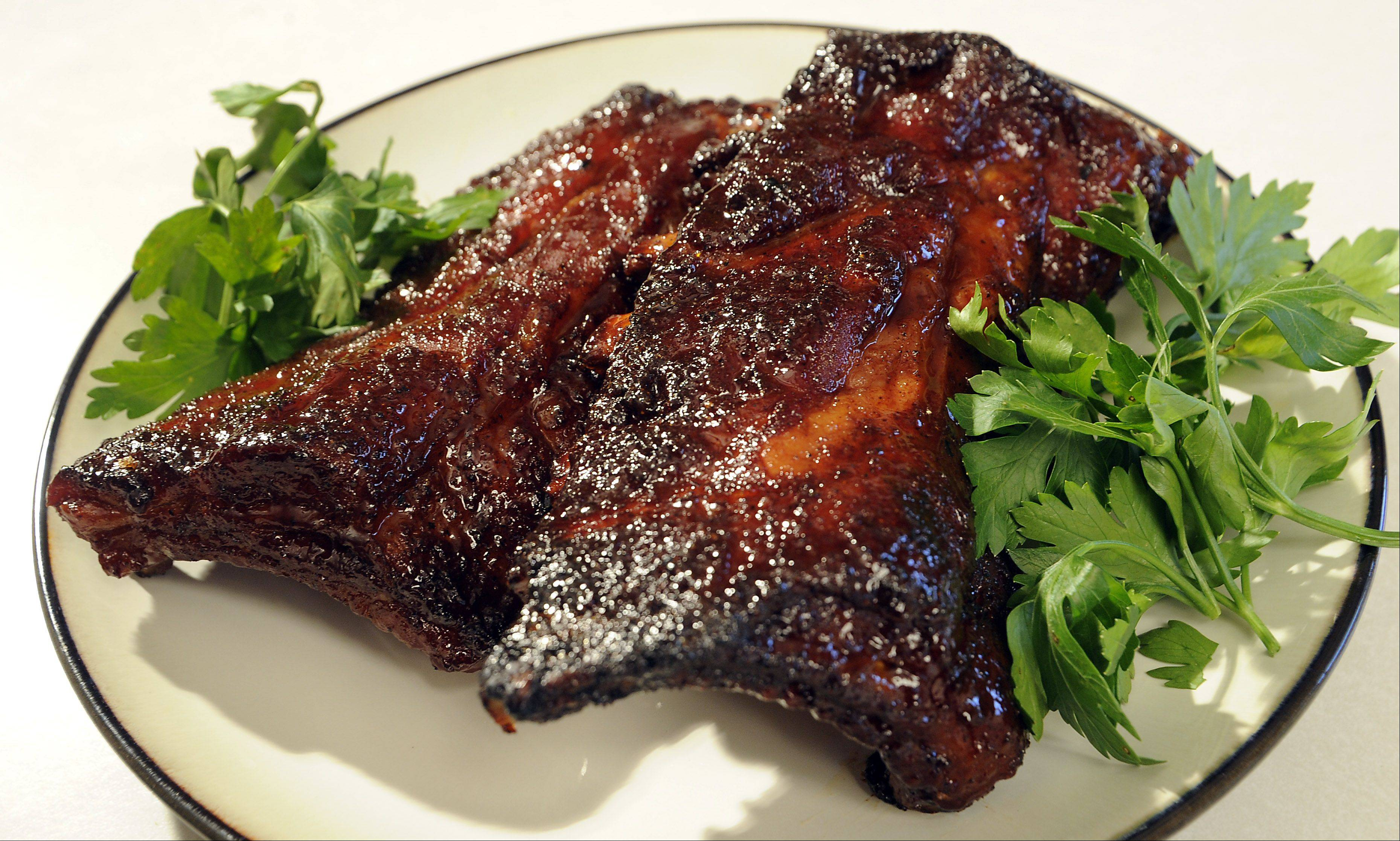Mark Welsh/mwelsh@dailyherald.com Bartlett�s Brad Anders� famous rib rub topping is a family favorite.