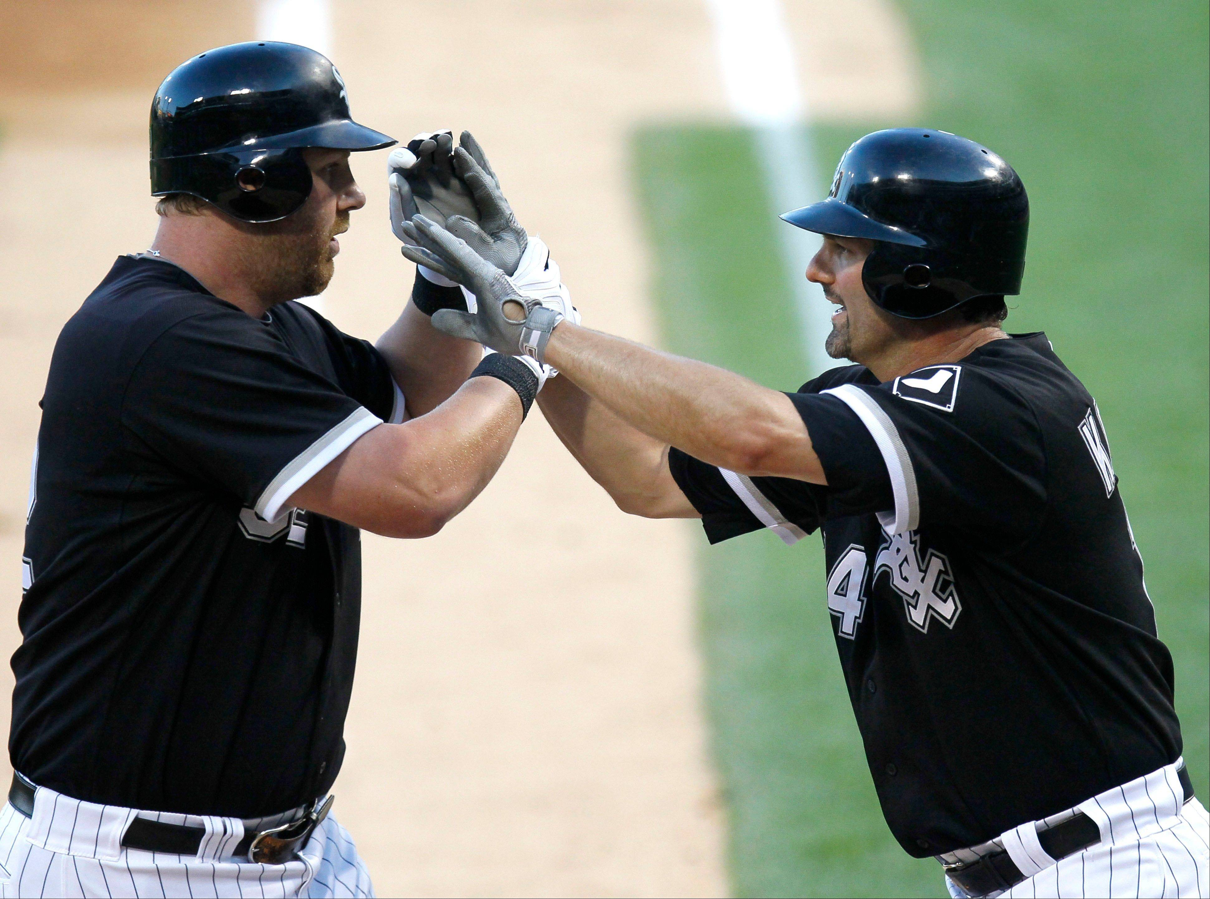 Adam Dunn, left, will resume designated hitter duties when Paul Konerko returns to the lineup at first base. Konerko has missed two games after being hit in the left knee with a pitch Sunday against the Tigers.