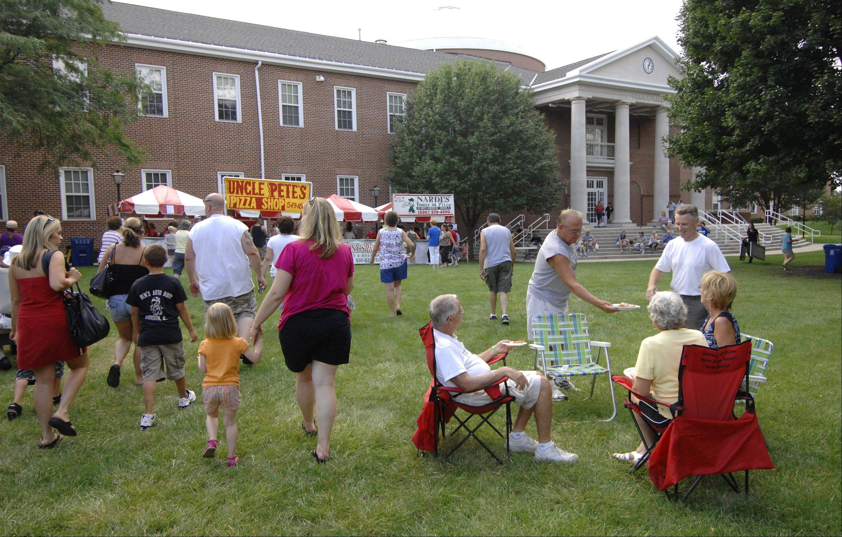 Addison residents enjoy a picnic atmosphere on the village hall lawn as part of National Night Out festivities.