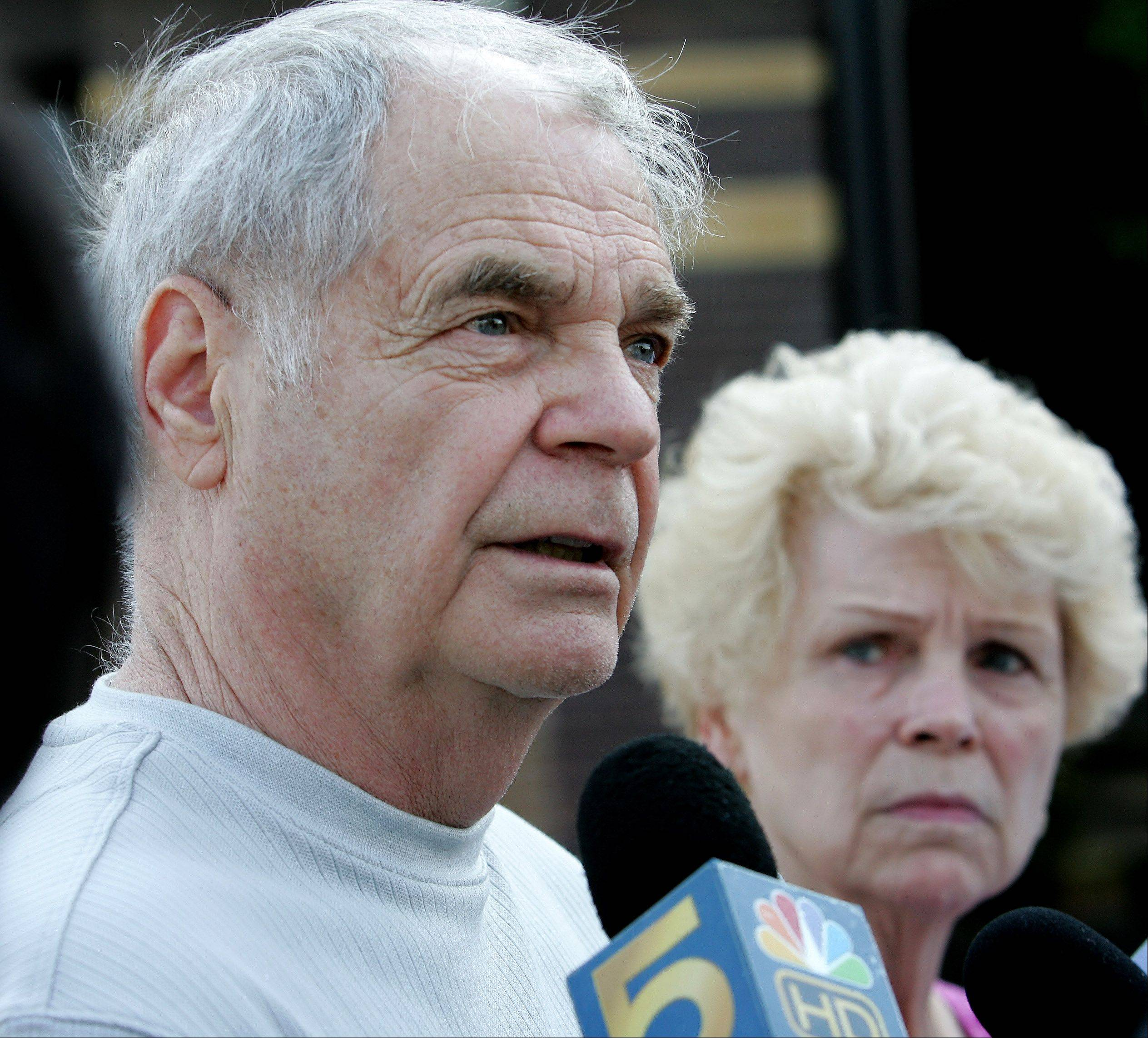 Wayne Wallar, with his wife, Fran, discusses the latest charges against Michael Whitney, convicted of the fatal stabbing Wayne's father, Cecil, in 1982.