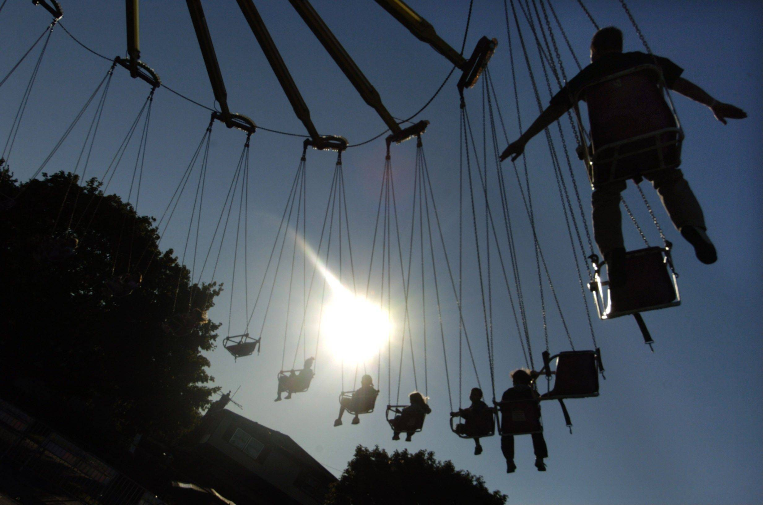Festival-goers enjoy the yo-yo swing ride.