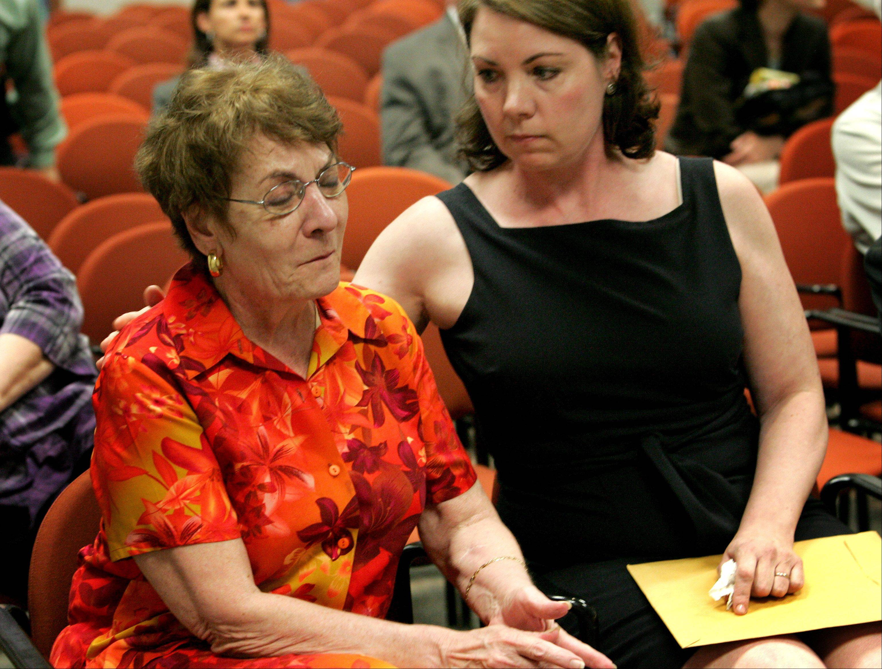 Teri Stack, left, is comforted by her great niece Michelle Hendrickson as they hear of charges filed in the 1976 murder of Teri's sister Darlene Stack.