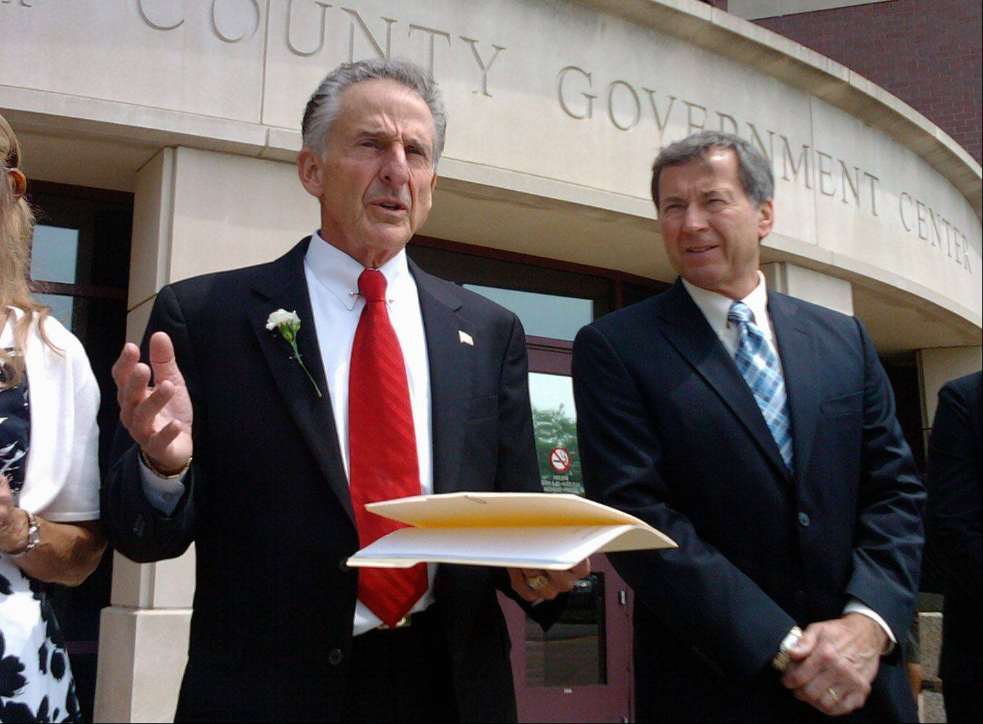 McHenry County State's Attorney Louis Bianchi, second from left, addresses supporters Tuesday outside the courthouse in Woodstock after his acquittal on misconduct charges. With him are defense attorneys Terry Ekl and Tracy Stanker.