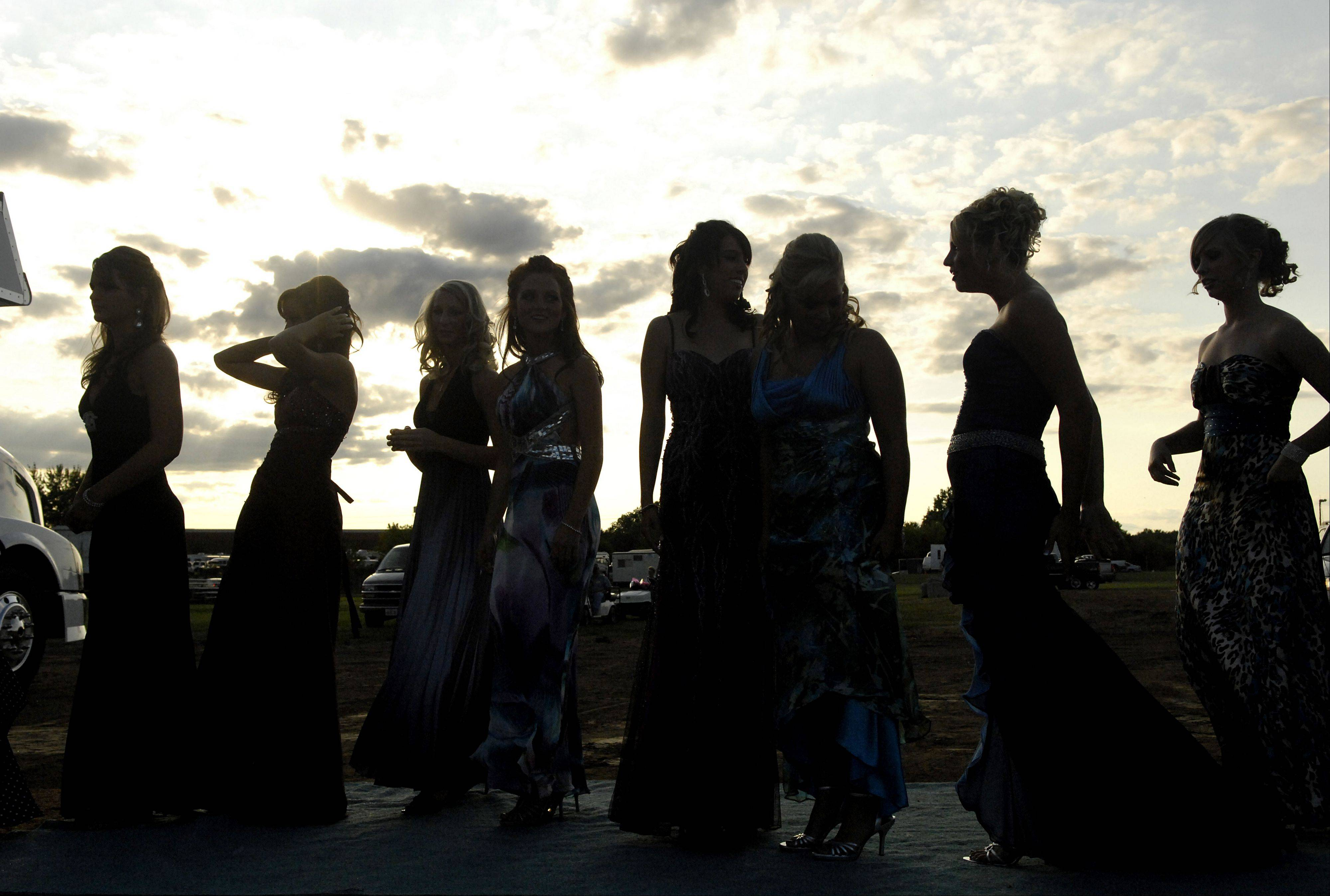 Eight of the 17 contestants for the Miss McHenry County Queen 2009 pageant line up on the carpet behind the stage in the Grandstand area at the McHenry County Fair in Woodstock. This year's pageant takes place at 7 p.m. today, Aug. 3.