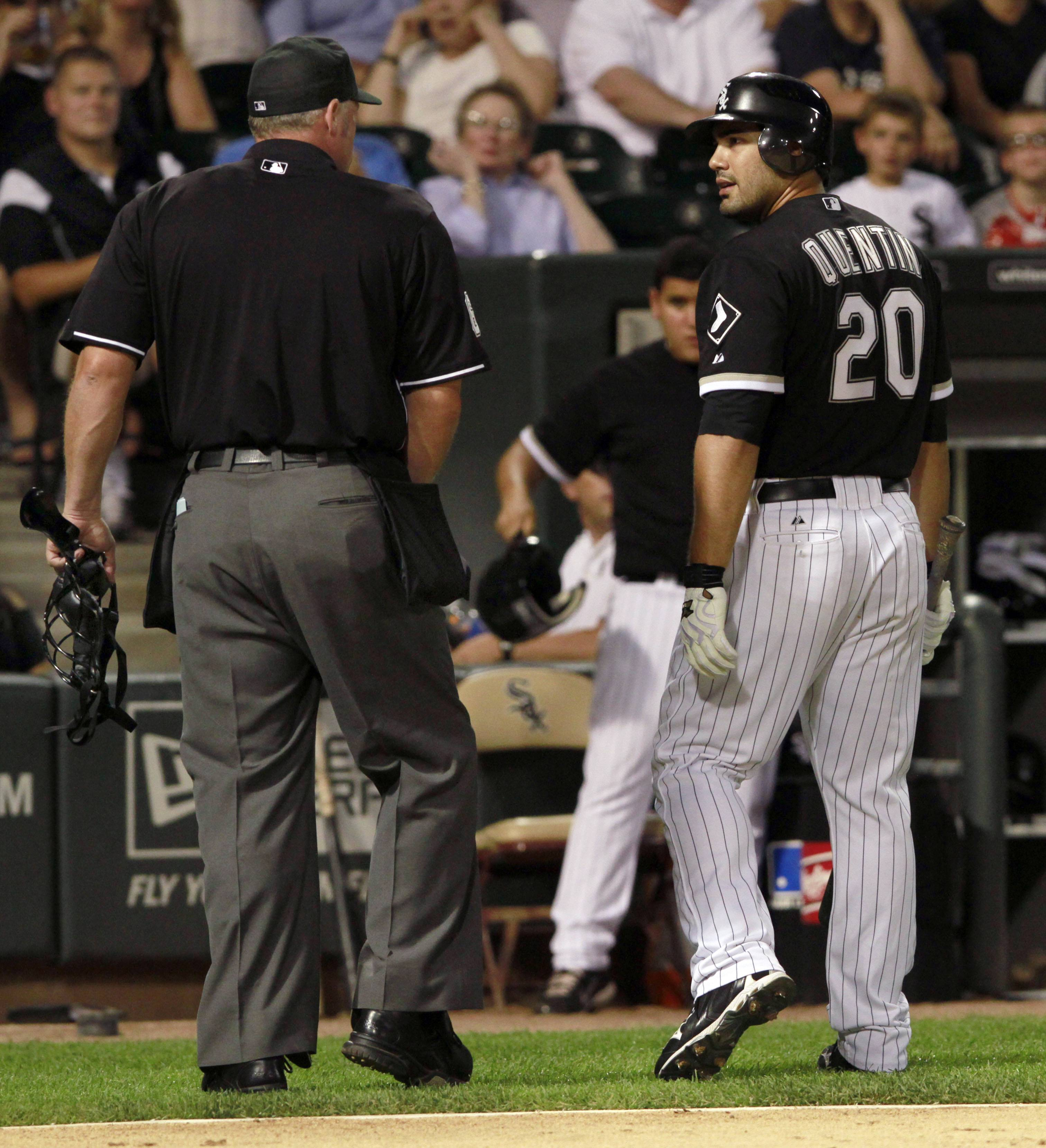 Carlos Quentin has a few words with home plate umpire Ted Barrett after striking out against the New York Yankees during the first inning.