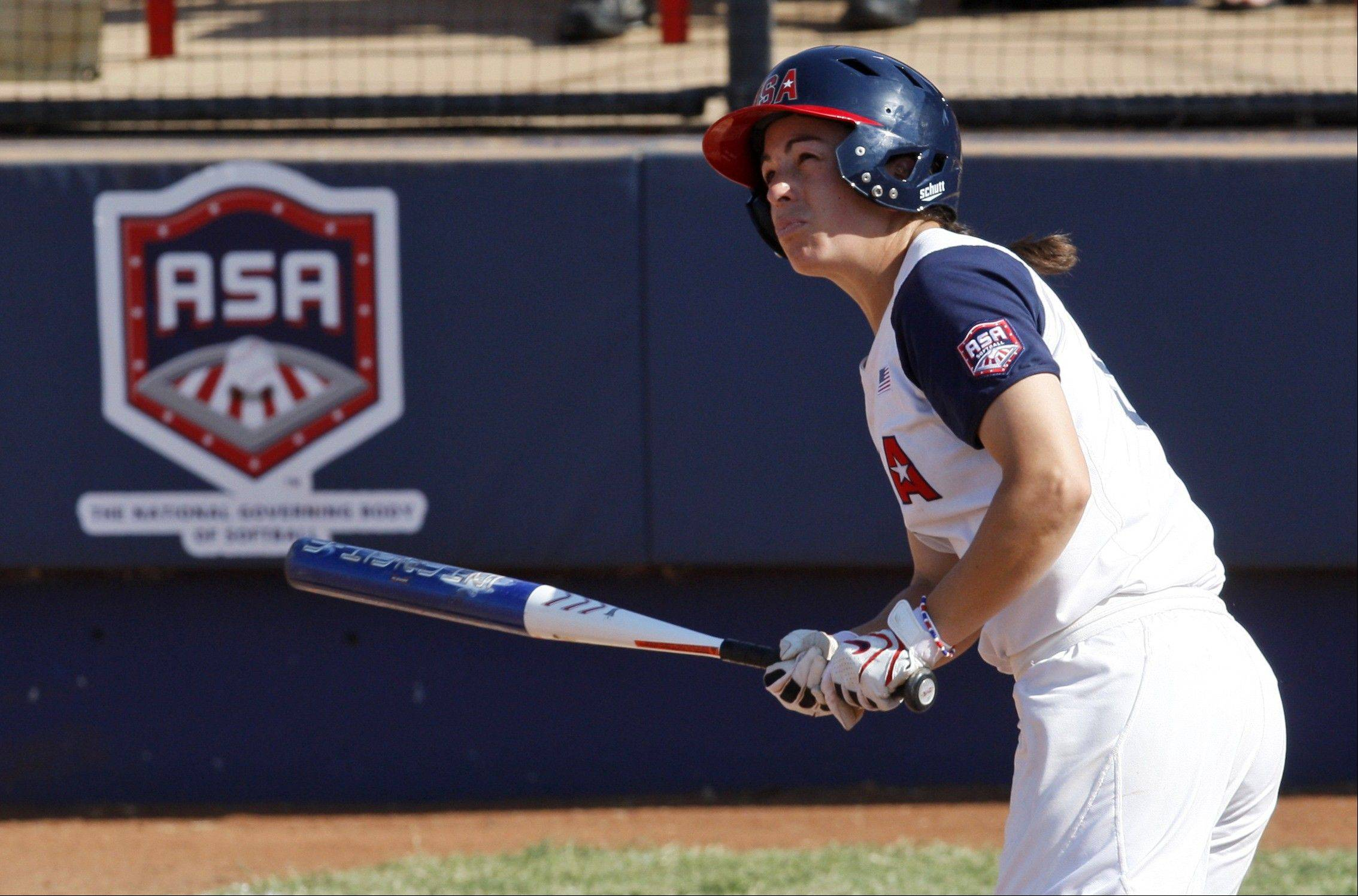 United States' Stacy May-Johnson watches her fourth-inning home run against Great Britain in a World Cup of Softball game in Oklahoma City on July 24, 2011. The United States won 10-0.