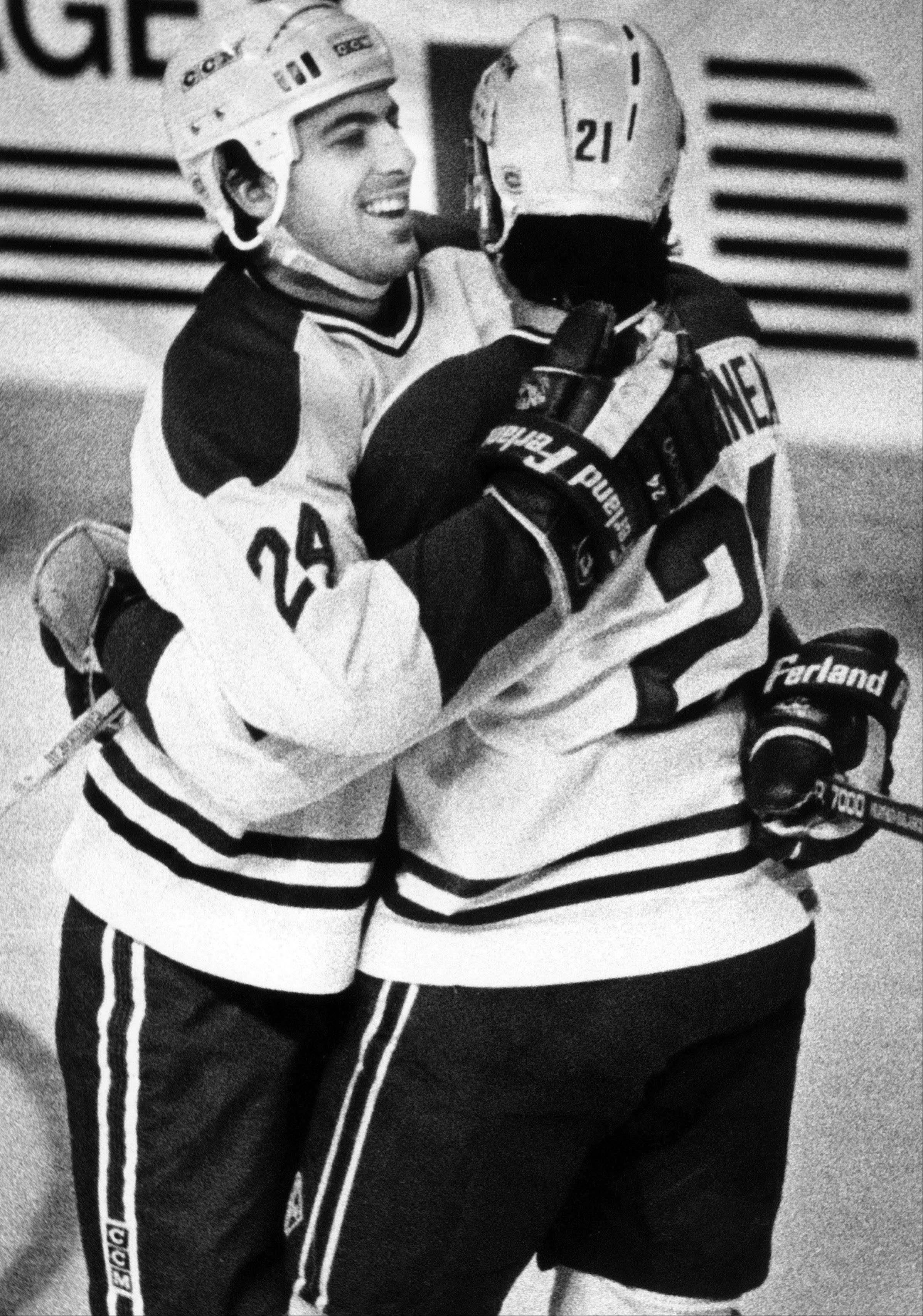 Montreal Canadiens' Chris Chelios, left, congratulates teammate Guy Carbonneau on his goal against the Edmonton Oilers during first period NHL action in Montreal in 1988.