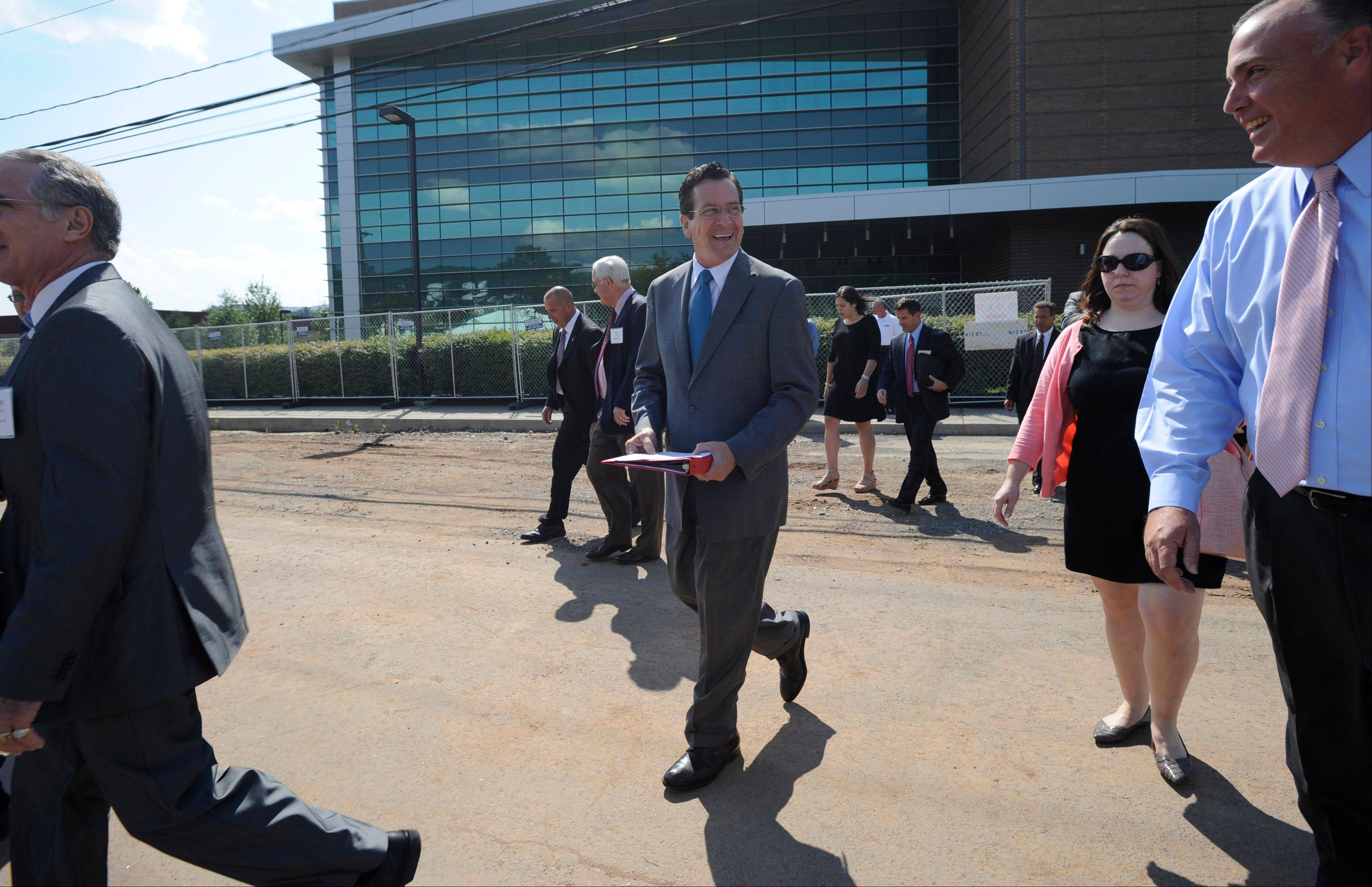 Connecticut Gov. Dannel P. Malloy, center, and officials from ESPN arrive Tuesday at a ground breaking ceremony for a new building on the campus of ESPN in Bristol, Conn. ESPN Will get a $17.5 million state loan to build its new Digital Center, plus up to $1.2 million for a job-training grant program.