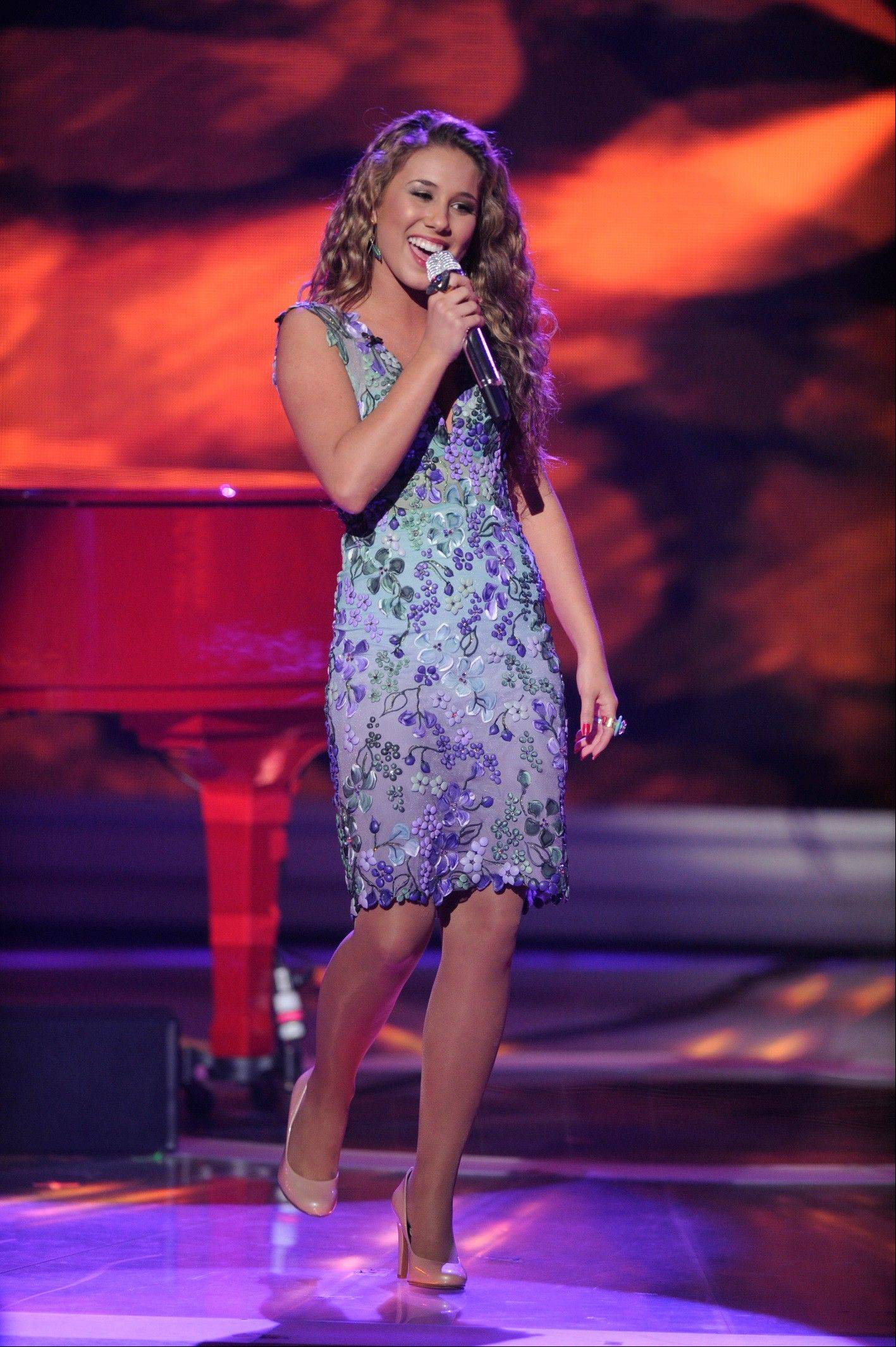 "Wheeling native and ""American Idol"" finalist Haley Reinhart performs in the American Idol Live! Tour 2011 Saturday at the Allstate Arena in Rosemont."