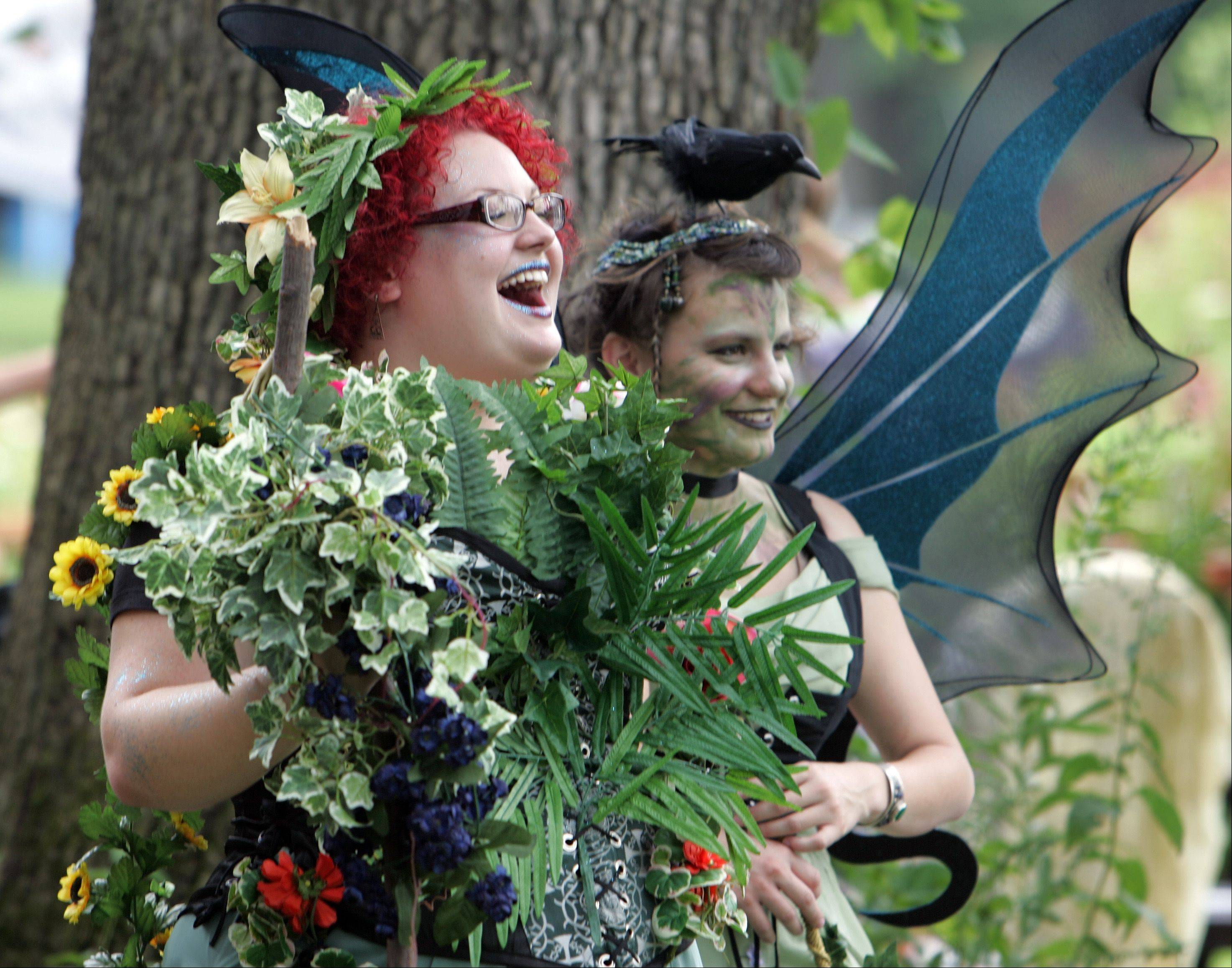 Emily Galasso, of Cary, left, and her sister Susan Galasso, of Madison Wis., share a laugh at last year's World of Faeries Festival at Vasa Park in South Elgin. This year's festival takes place Saturday and Sunday, Aug. 6-7.