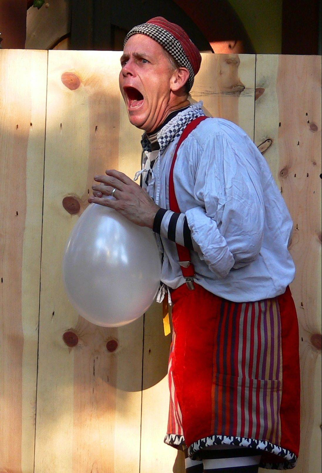 Phil Johnson of Mundelein combines juggling, balance, and comedy to enthrall crowds while performing as MooNiE the Magnif'Cent at the Bristol Renaissance Faire.