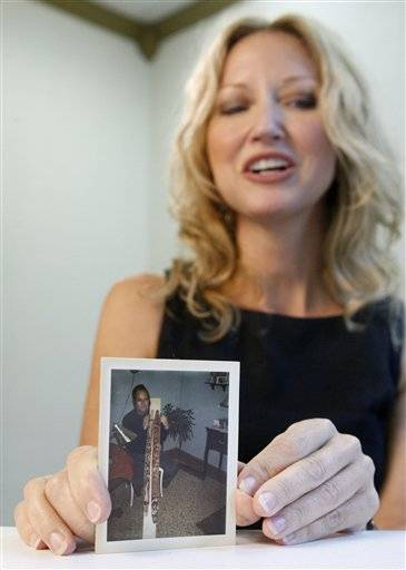 Marla Cooper holds a photograph of her late uncle Lynn Doyle Cooper.