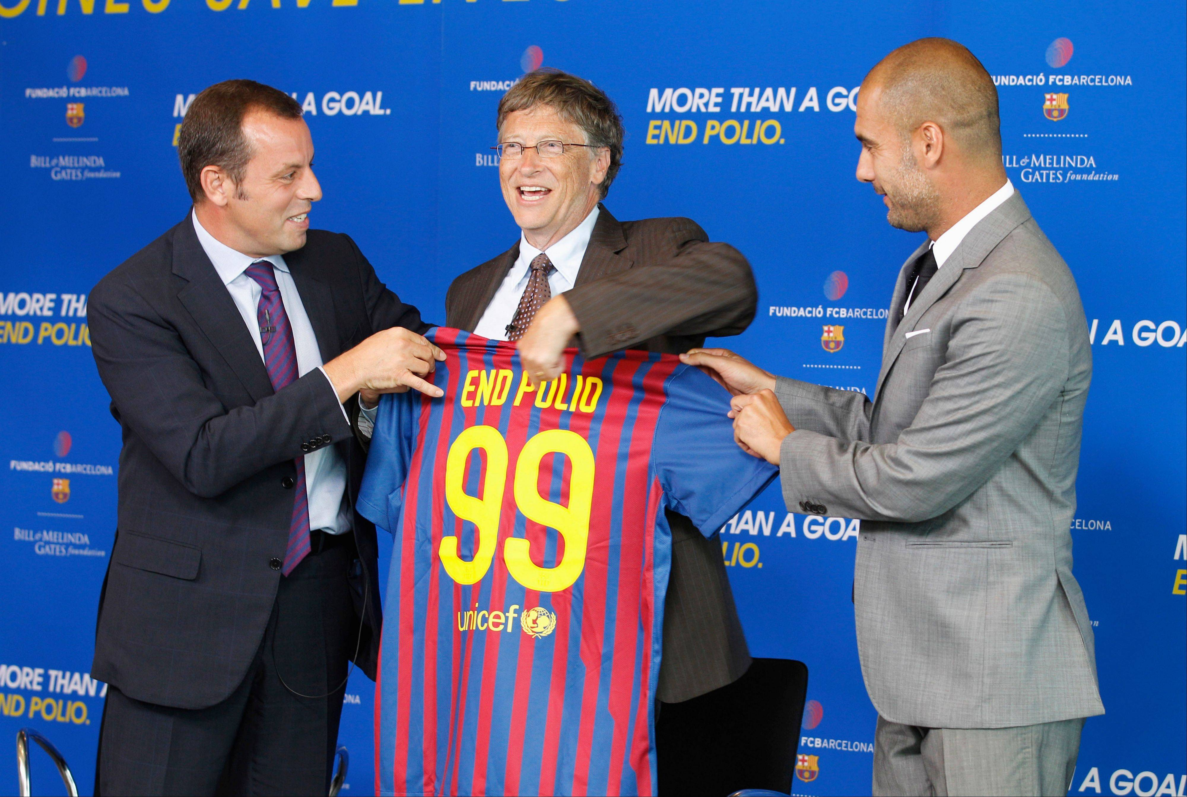 Bill Gates, co-chair of the Bill & Melinda Gates Foundation, center, with FC Barcelona President Sandro Rosell, left, and Barcelona coach Josep Guardiola, holds up a Barcelona jersey during announcement last week in Washington of a partnership between FC Barcelona and the Bill and Melinda Gates Foundation to End Polio and Give Every Child and Equal Shot at Life.