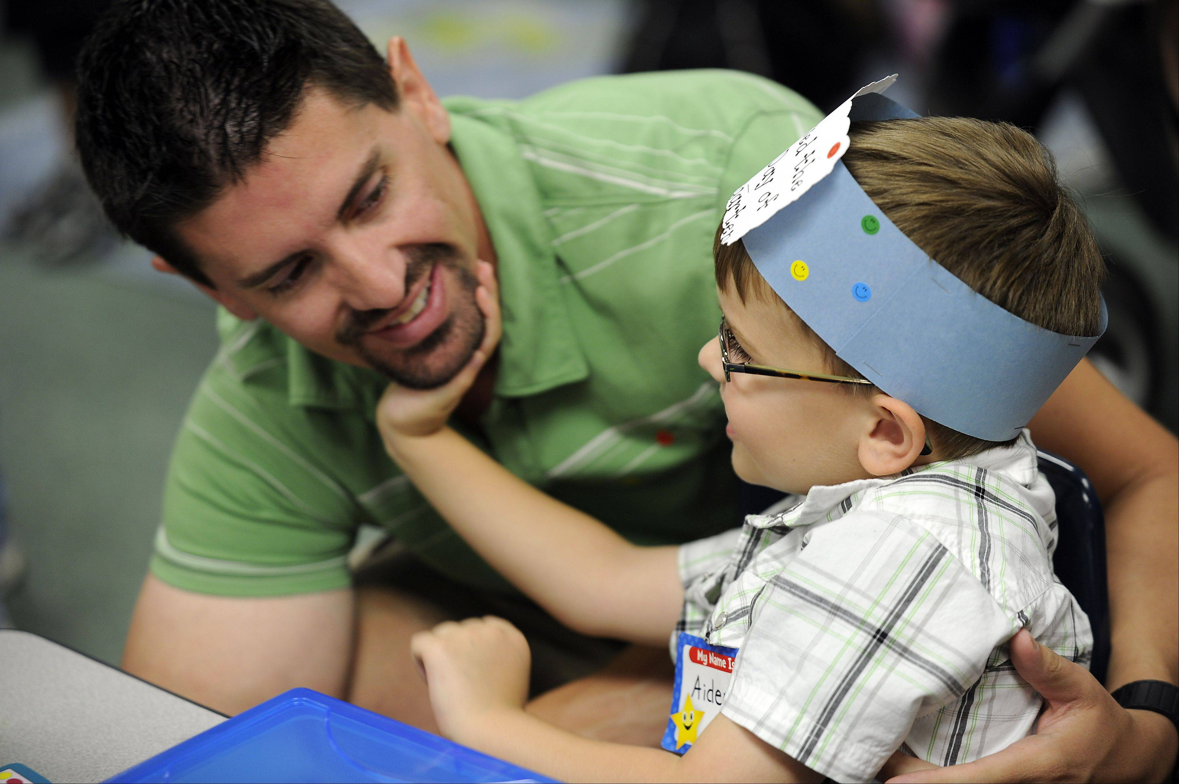 John and his son Aiden Weck, 5, of Arlington Heights play in his classroom at the Ridge Family Center for Learning in Elk Grove Village as part of the open house on Wednesday.