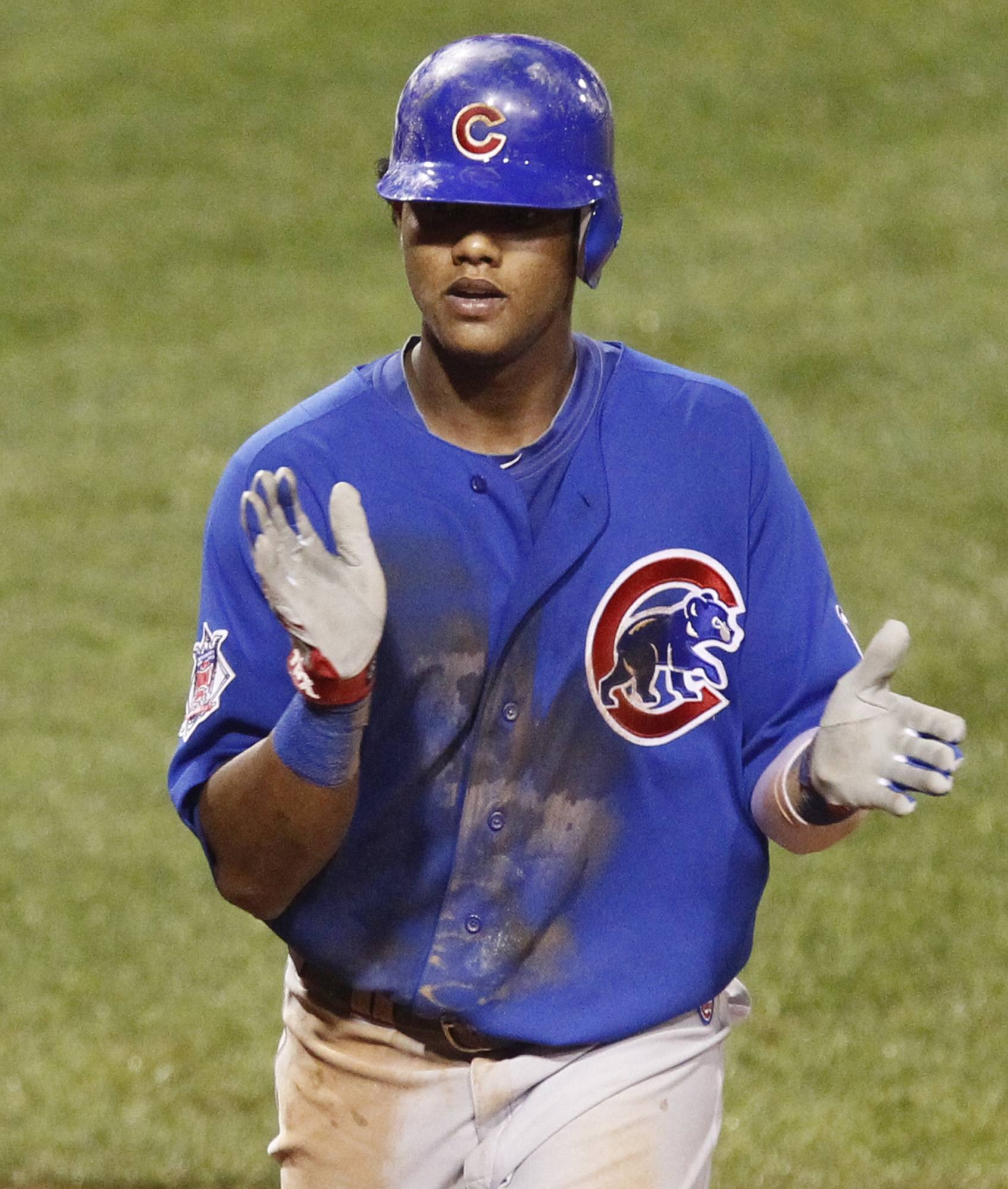 Starlin Castro celebrates as he crosses the plate after hitting a solo-home run off Pittsburgh Pirates pitcher Chris Resop in the eighth inning Wednesday night.