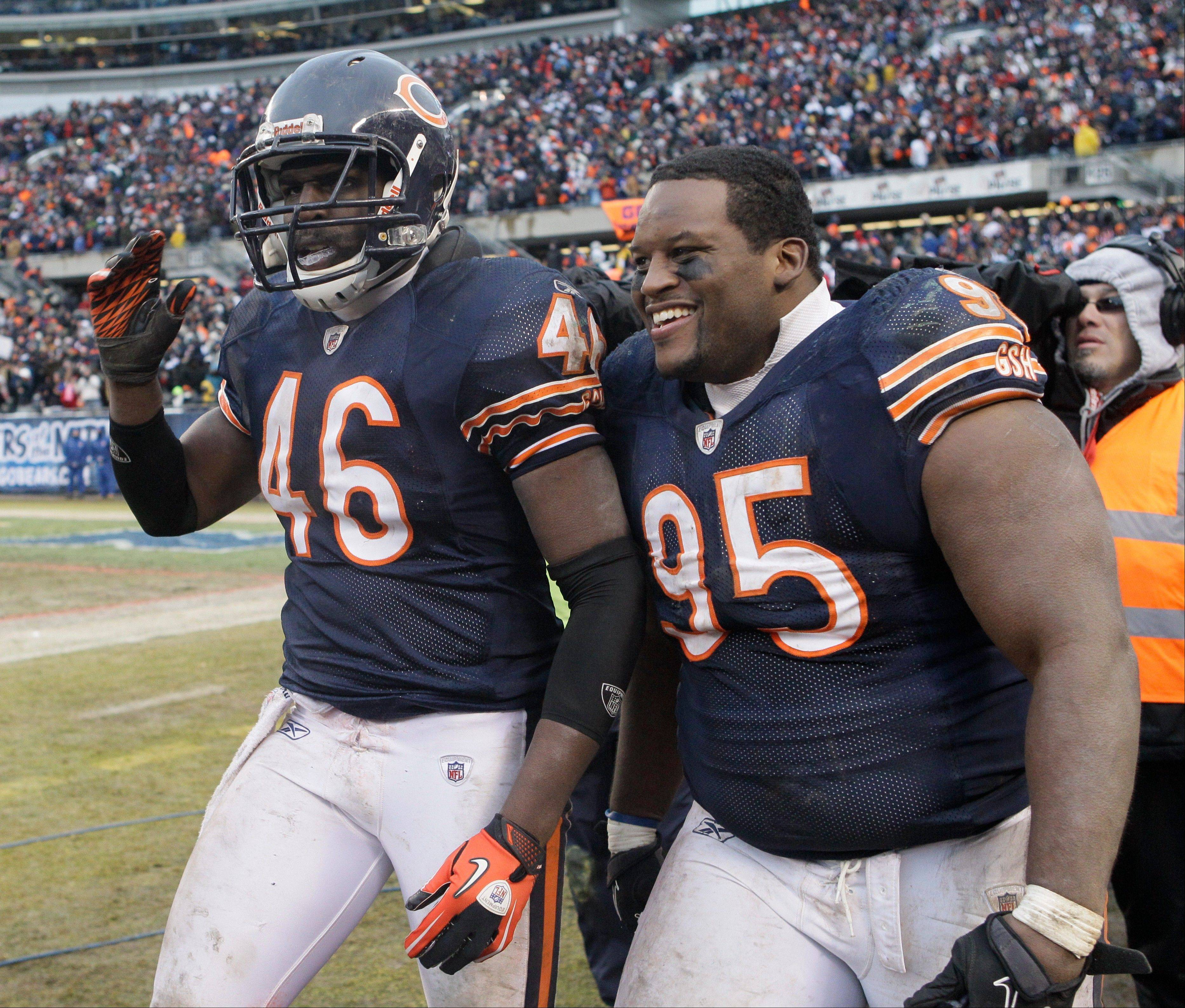 Chicago Bears defensive tackle Anthony Adams (95) walks off the field with Chris Harris (46) after a victory over the Jets last December.