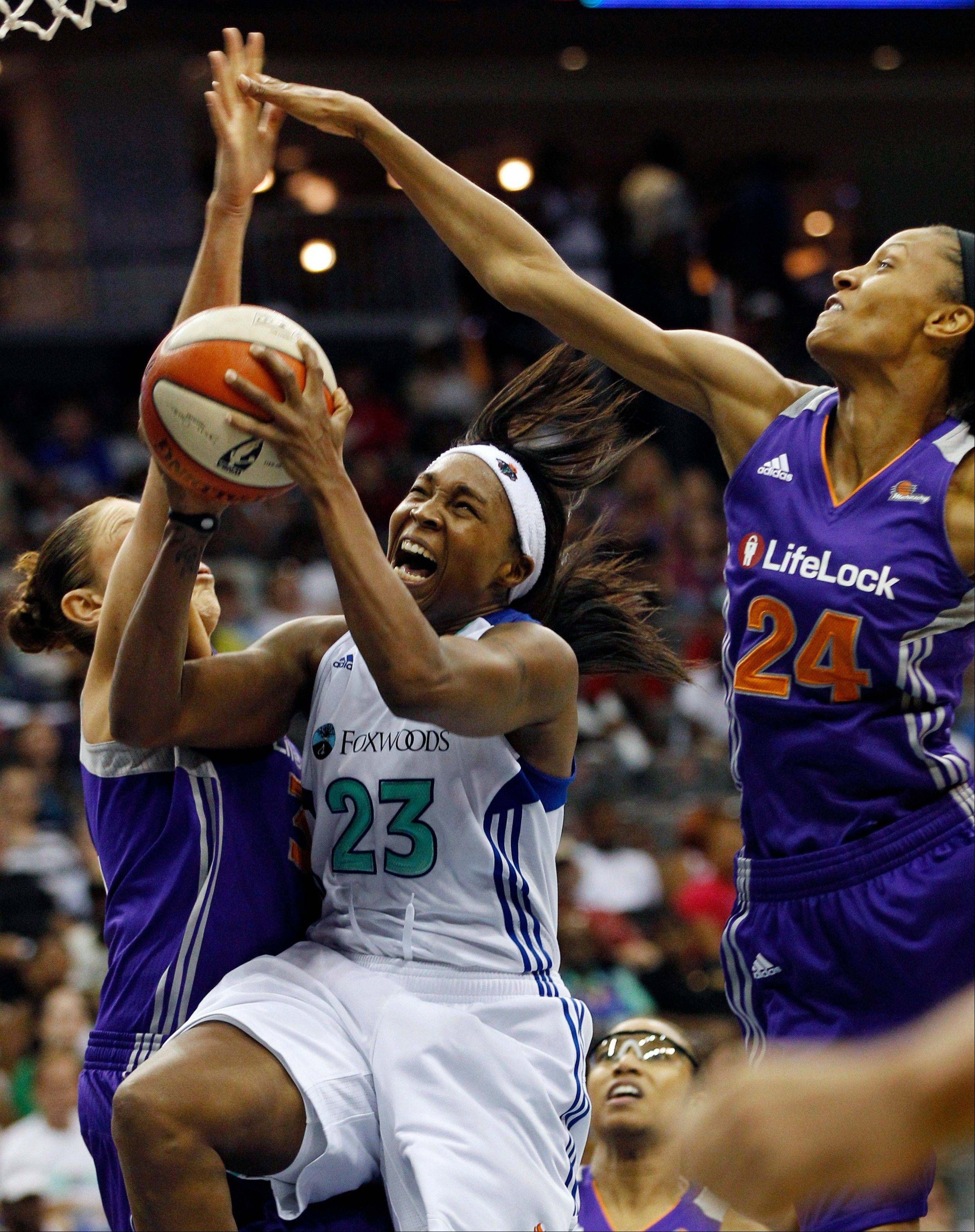 New York Liberty's Cappie Pondexter, a Chicago native, takes a shot past Phoenix Mercury's Diana Taurasi, left, and DeWanna Bonner during their WNBA game in Newark, N.J., last Saturday. The Sky plays the LIberty on the road Thursday.