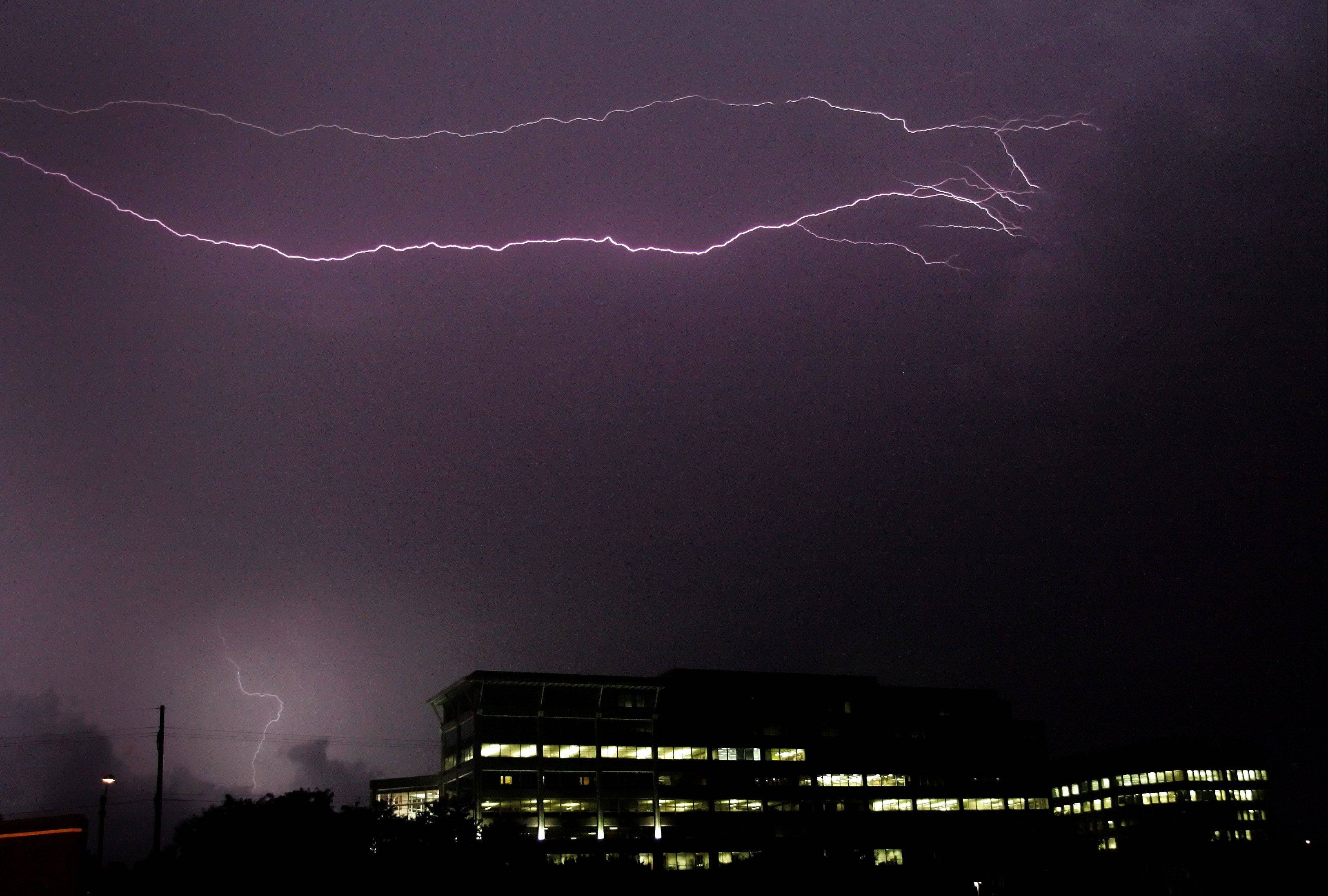 Bev Horne/bhorne@dailyherald.com Lightning strikes as a storm passes through DuPage County on Tuesday night.