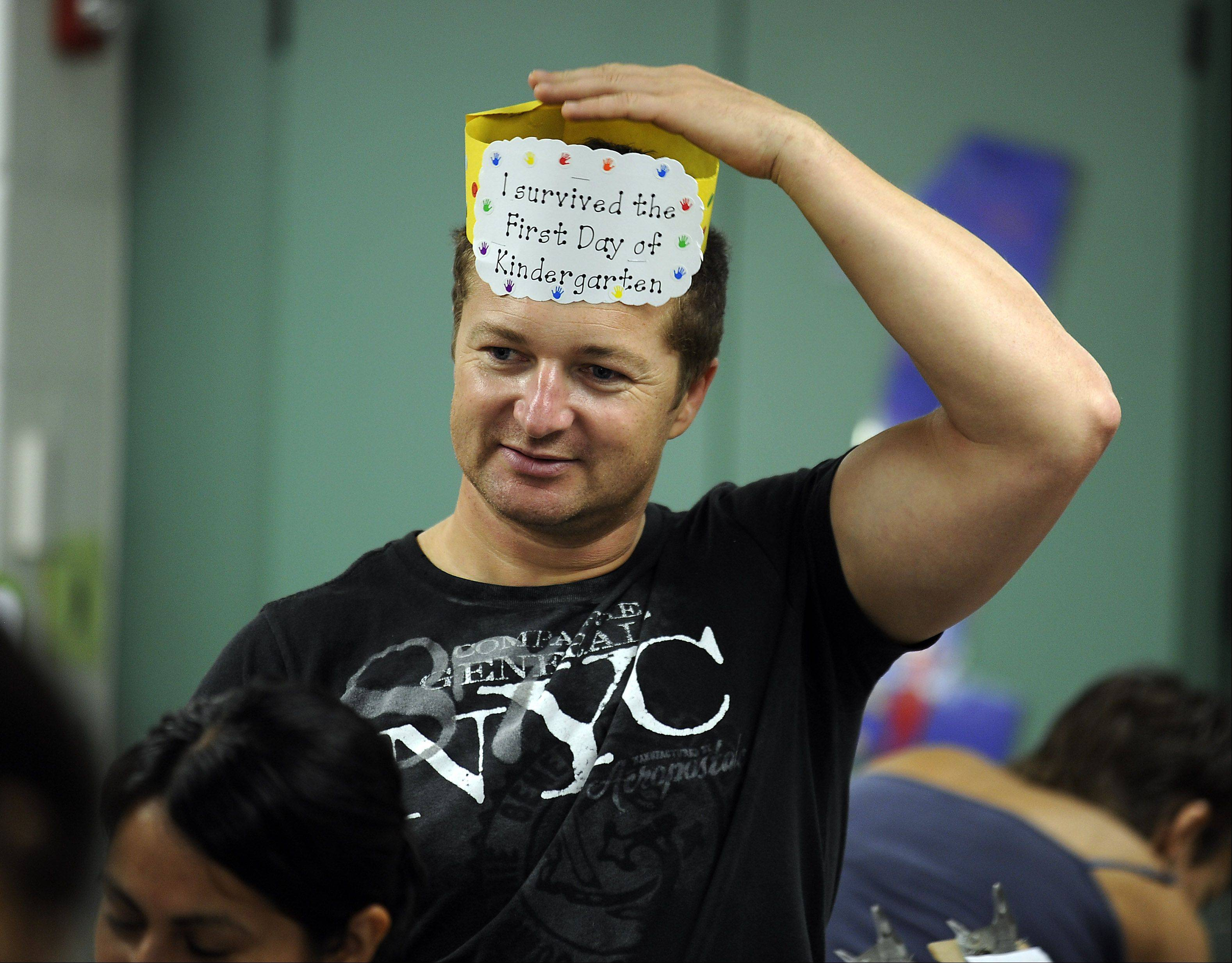 Boguslain Szczepanik gets into the spirt of things in his daughter Vanessa's classroom, stealing the hat she made as part of the open house at the Ridge Family Center for Learning in Elk Grove Village.