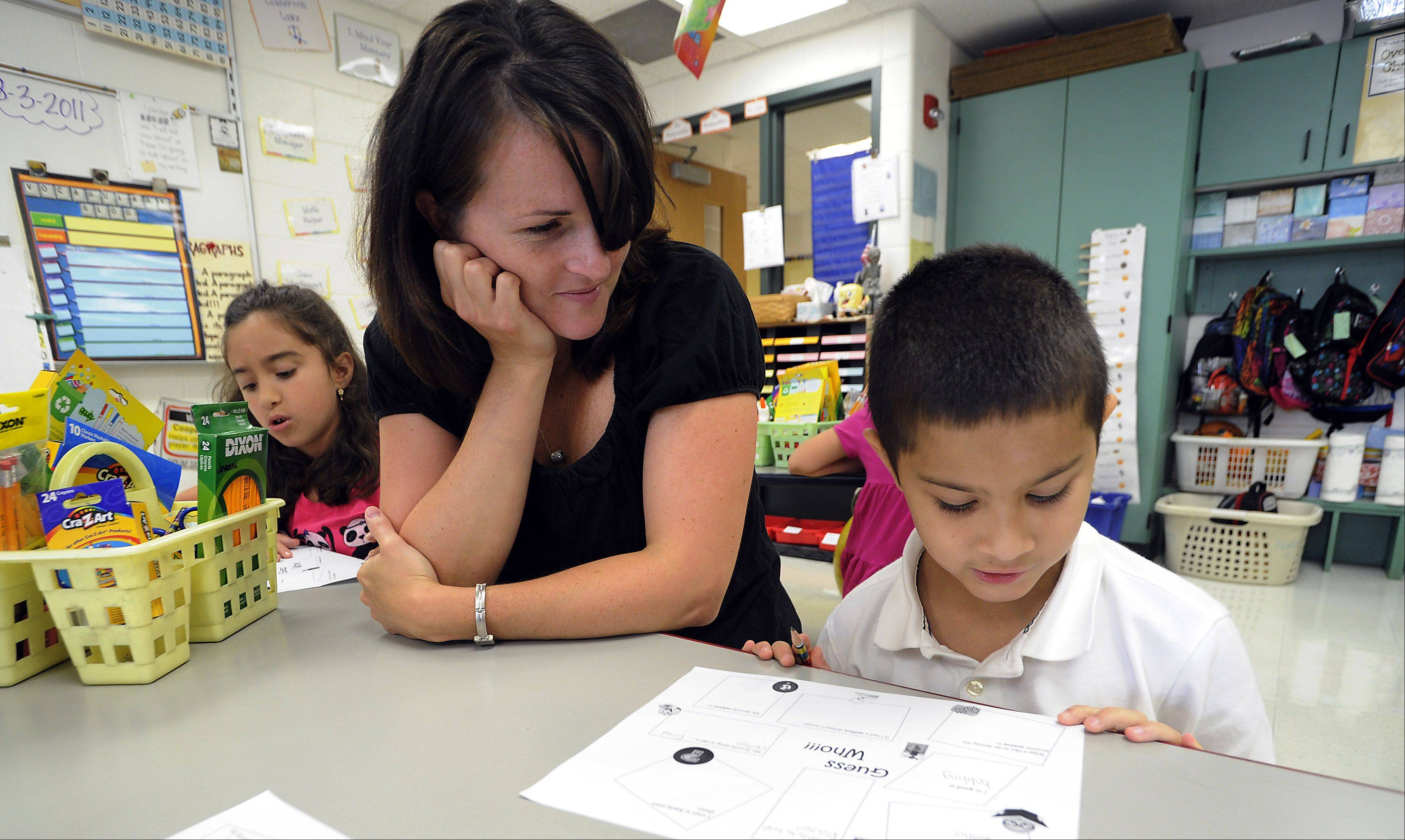 Teacher Katie Rowley works with student Jovanni Ivel, 7, of Elk Grove Village in his 3rd grade classroom at the Ridge Family Center for Learning as part of the open house on Wednesday.