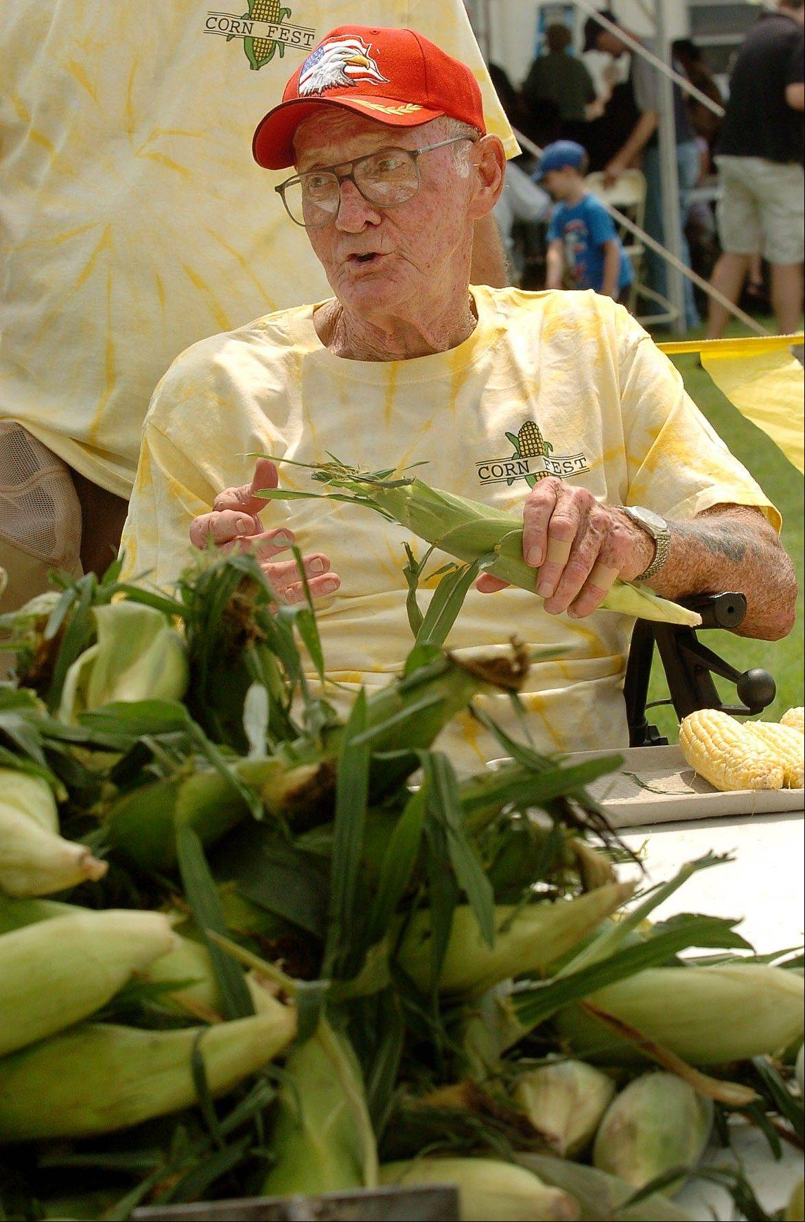 DAILY HERALD FILE PHOTOTony Voleck of Rolling Meadows has a pile of corn to husk for the 2010 Cornfest.