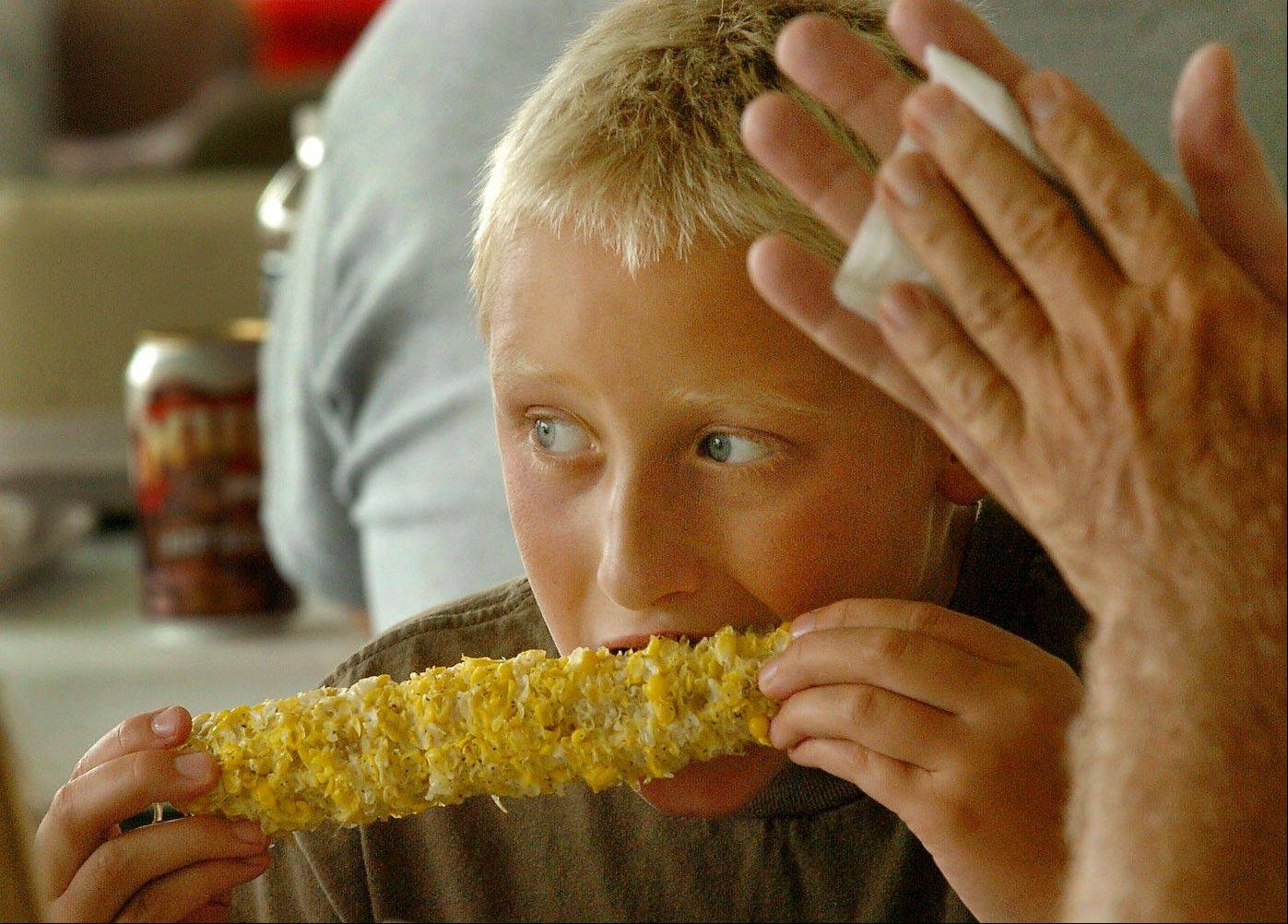 DAILY HERALD FILE PHOTOTen-year-old Josh Dellorto of Arlington Heights tears into an ear of corn at the fest last year.