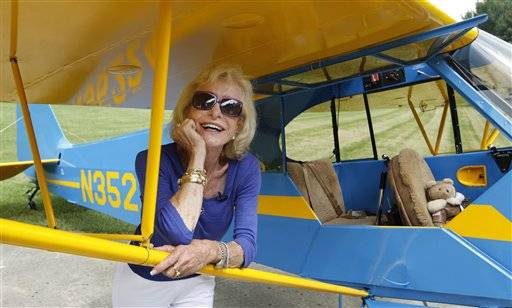 Myrtle Rose, 75, checks out her 1941 Piper J-3 Cub after a brief flight from the airstrip at her home, Friday, Aug. 5, 2011, in South Barrington. The aviation enthusiast was out for a quick flight on Wednesday when she saw two F-16 fighter jets out her cockpit window after she strayed into restricted airspace during a visit to Chicago by President Barack Obama. Rose says she's filed a report with the Federal Aviation Administration explaining she didn't know she wasn't supposed to fly in the area that day.