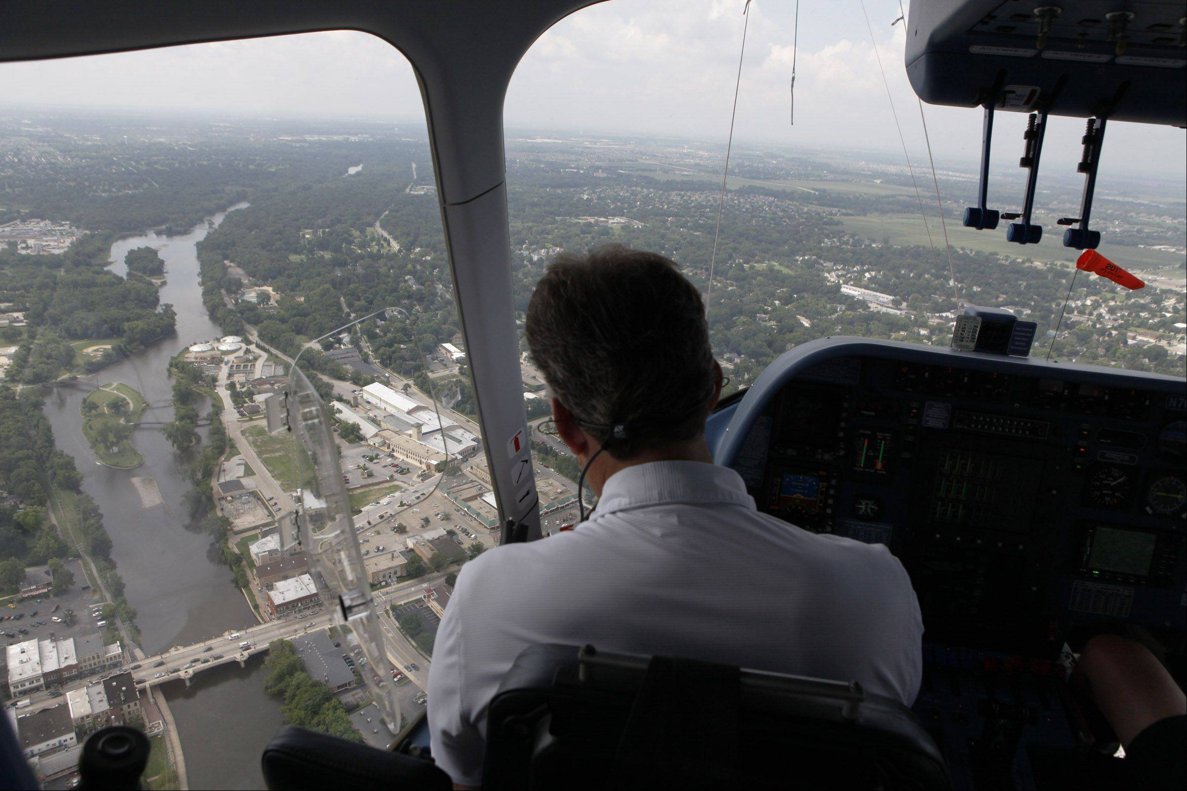 Pilot Jim Dexter flies the Farmers Insurance Zeppelin airship over the Fox River Friday.
